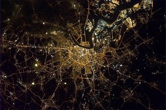 Antwerp, Belgium with the Scheldt river like lightning sparking up the city.  (Photo & Caption: Chris Hadfield/NASA)