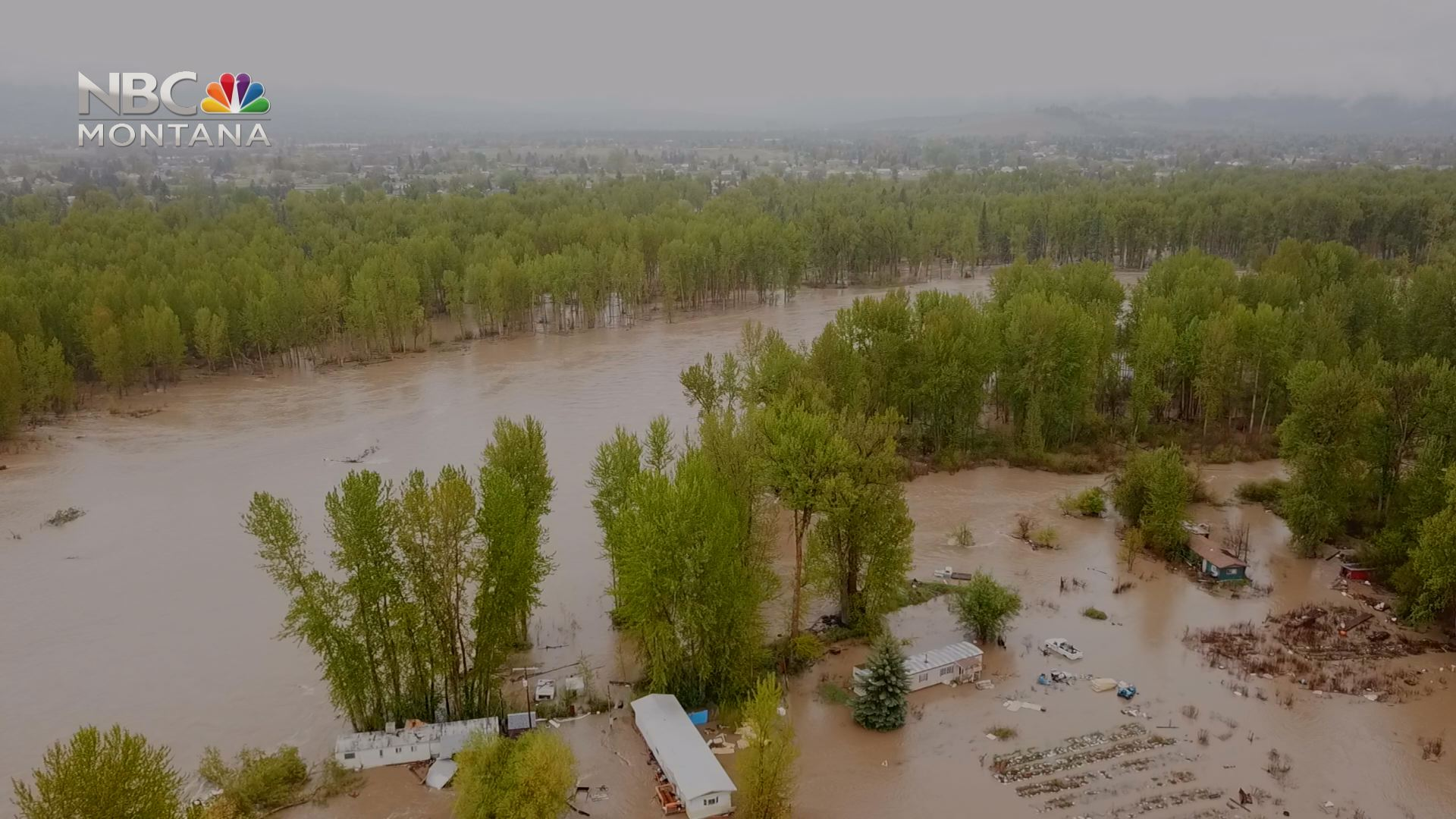 Devastating flood damage from Schmidt Road, across the Clark Fork, to the Orchard Homes neighborhood.