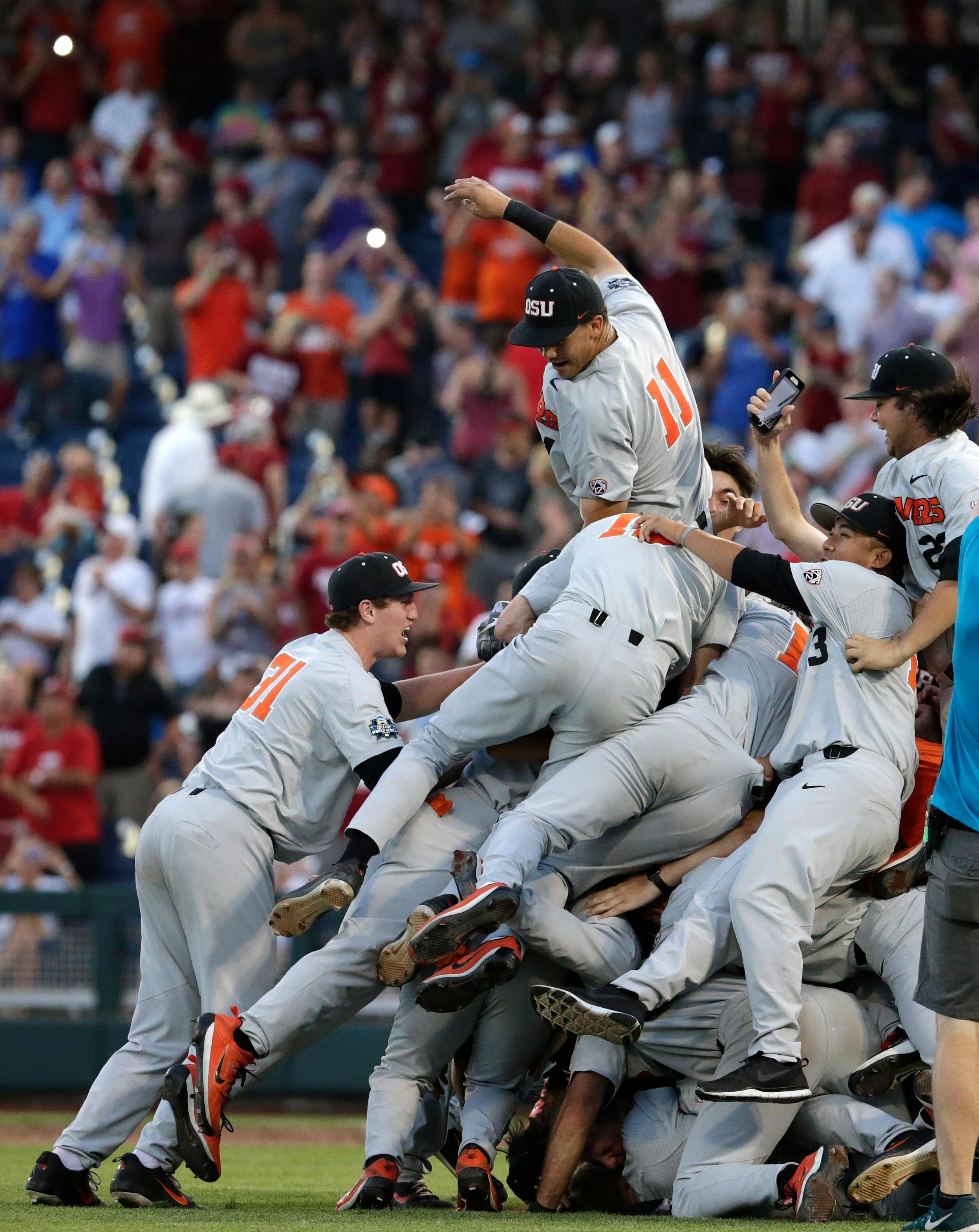 Oregon State players celebrate after they beat Arkansas 5-0 in Game 3 to win the NCAA College World Series baseball finals, Thursday, June 28, 2018, in Omaha, Neb. (AP Photo/Nati Harnik)