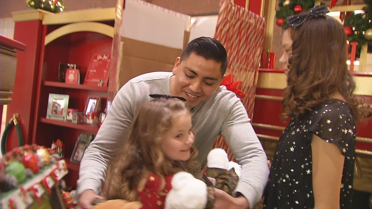 Sgt. Edwin Hernandez, a Marine stationed in Japan, surprised his nieces Friday at Asheville Mall. (Photo credit: WLOS staff)