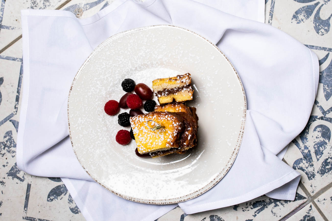 Hong Kong French Toast: deep-fried shokupan filled with Nutella and topped with powdered sugar and fresh berries / Image: Amy Elisabeth Spasoff // Published: 5.22.18
