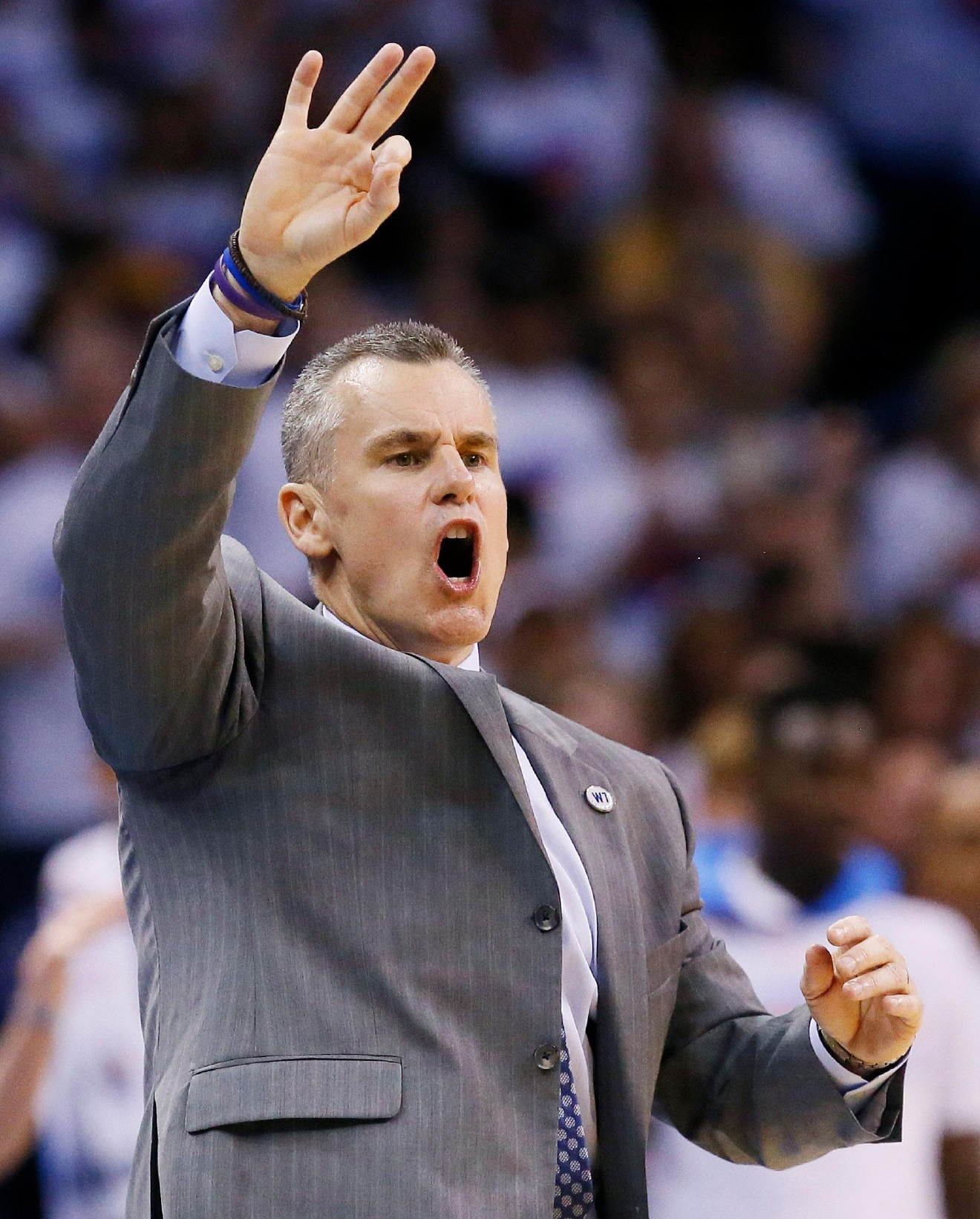 Oklahoma City Thunder head coach Billy Donovan makes a call against the Golden State Warriors during the second half in Game 4 of the NBA basketball Western Conference finals in Oklahoma City, Tuesday, May 24, 2016. (AP Photo/Sue Ogrocki)