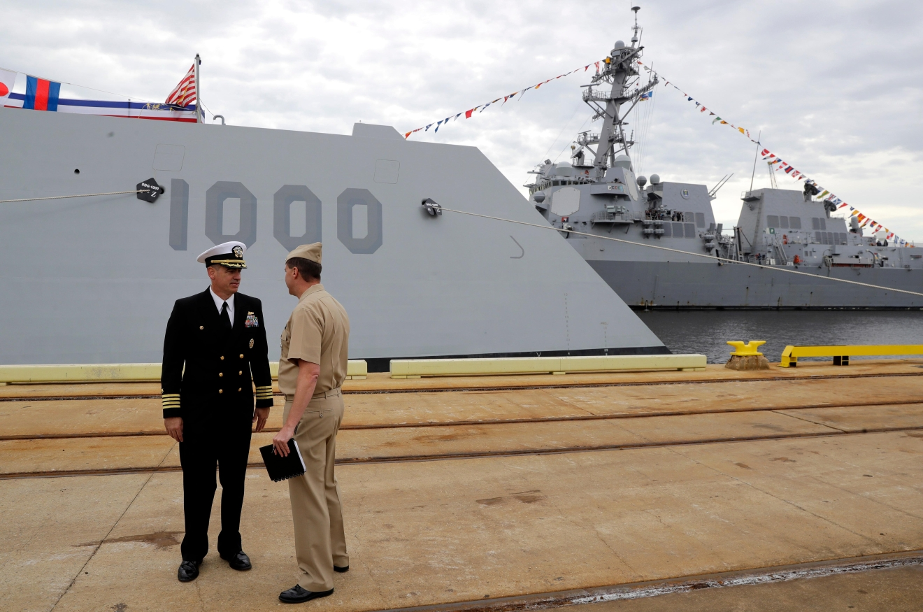In this Oct. 13, 2016 photo, Capt. James Kirk, left, commanding officer of the future USS Zumwalt, speaks on a dock in front of his ship in Baltimore. The destroyer's commissioning ceremony is set for Oct. 15 in Baltimore, and its home port will be in San Diego. (AP Photo/Patrick Semansky)