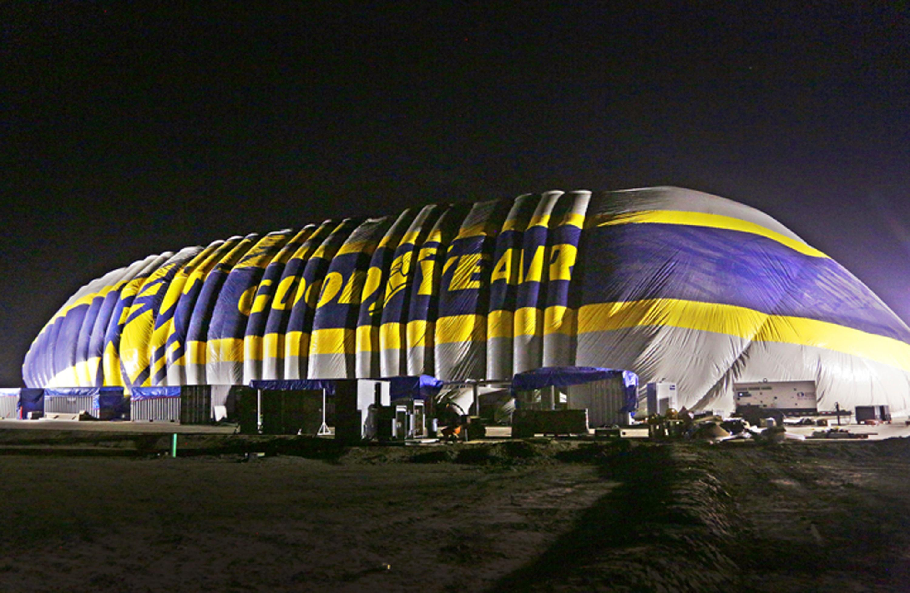 This photo provided by the Goodyear Tire & Rubber Co. shows the nearly-complete inflation of a giant inflatable hangar that will be the permanent home of one of the company's new semi-rigid airships,  Wednesday, Dec. 13, 2017 in Carson, Calif. The building standing nine stories tall and stretching the length of a football field went up early Wednesday along Interstate 405 south of Los Angeles. (Goodyear Tire & Rubber Co. via AP)