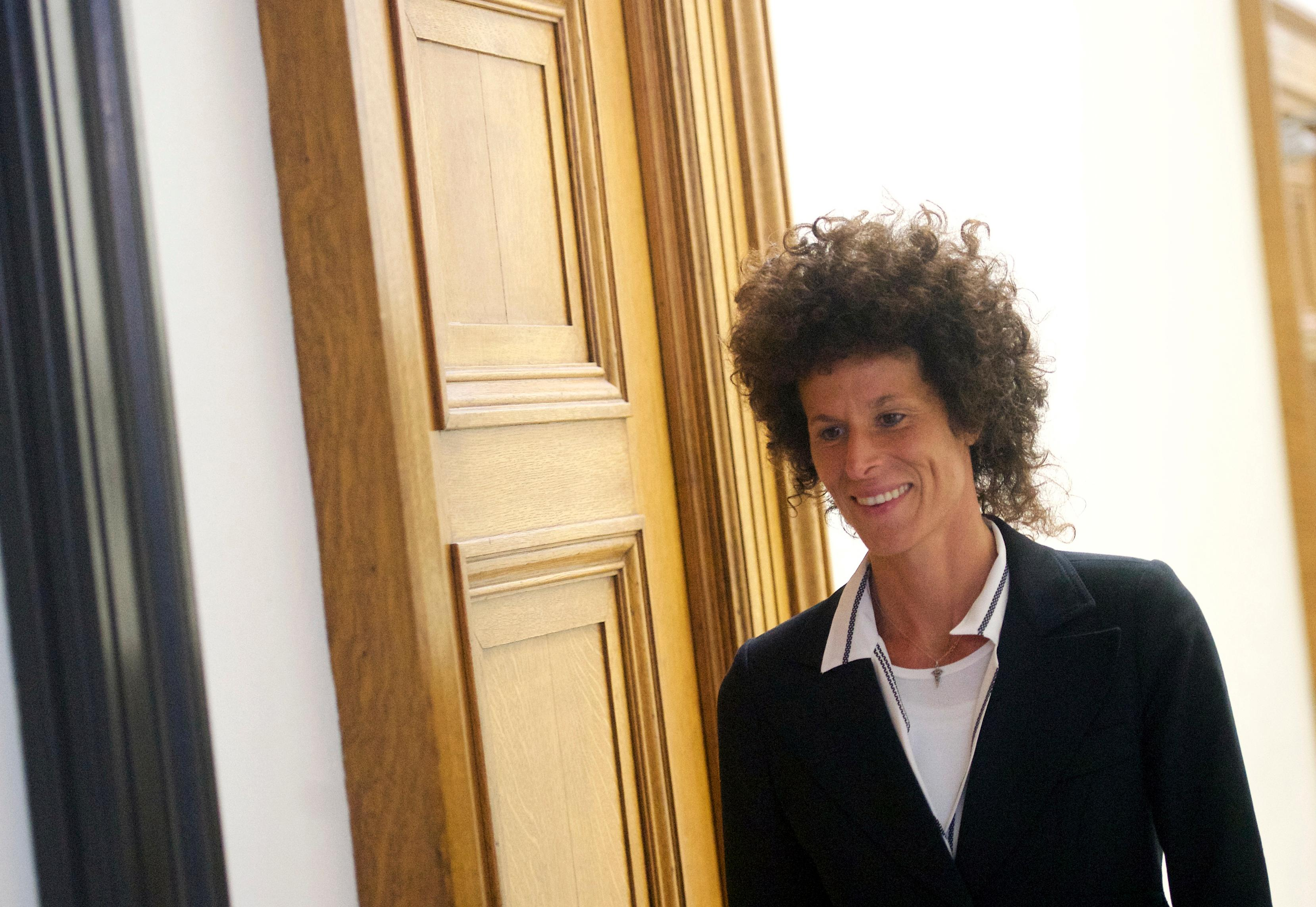Andrea Constand exits the courtroom during jury deliberations in Bill Cosby's his sexual assault trial at the Montgomery County Courthouse in Norristown, Pa., Wednesday, June 14, 2017. Cosby is accused of drugging and sexually assaulting Constand at his home outside Philadelphia in 2004. (Mark Makela/Pool Photo via AP)