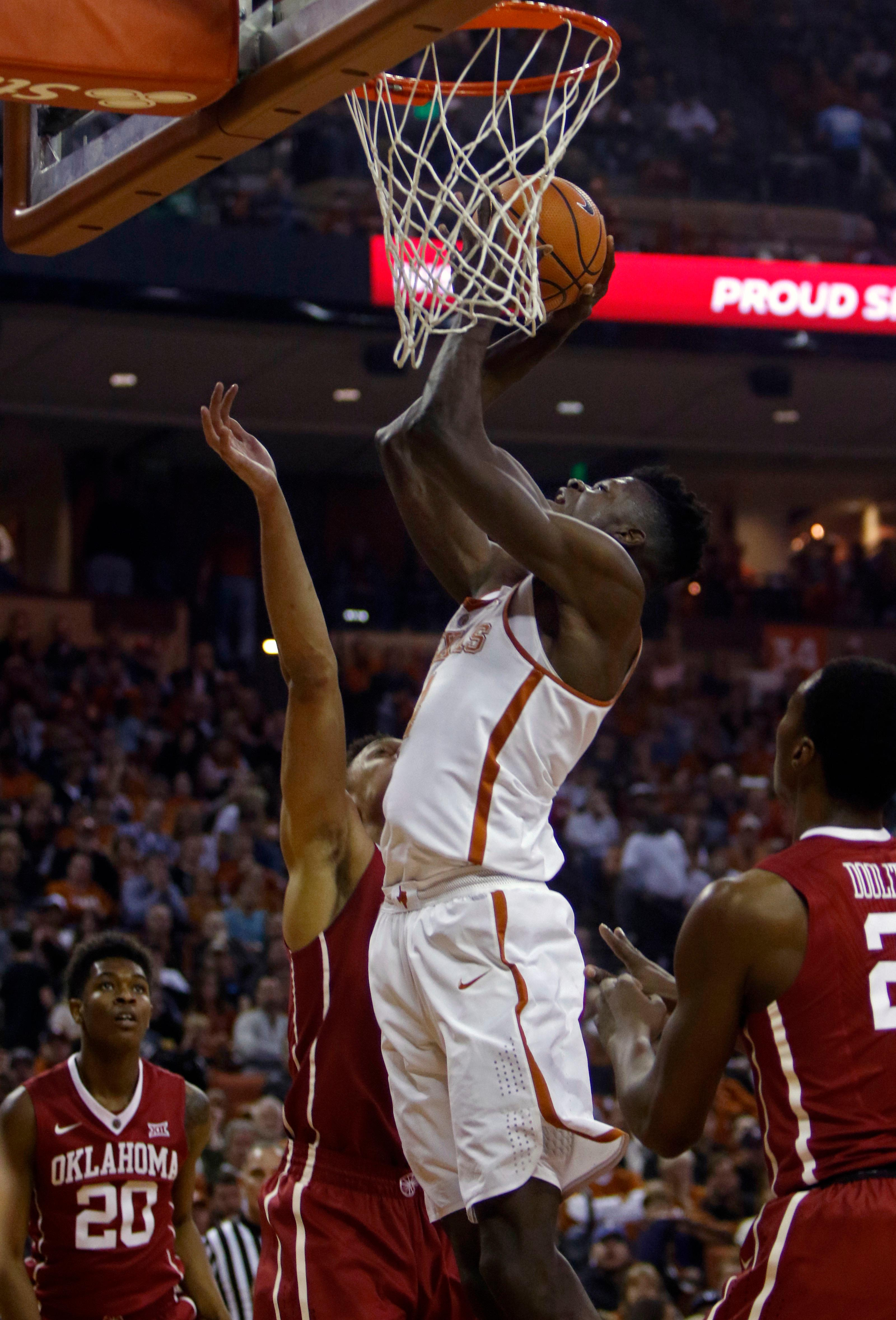 Texas center Mohamed Bamba, right, shoots against Oklahoma center Jamuni McNeace, left, during the first half of an NCAA college basketball game, Saturday, Feb. 3, 2018, in Austin, Texas. (AP Photo/Michael Thomas)