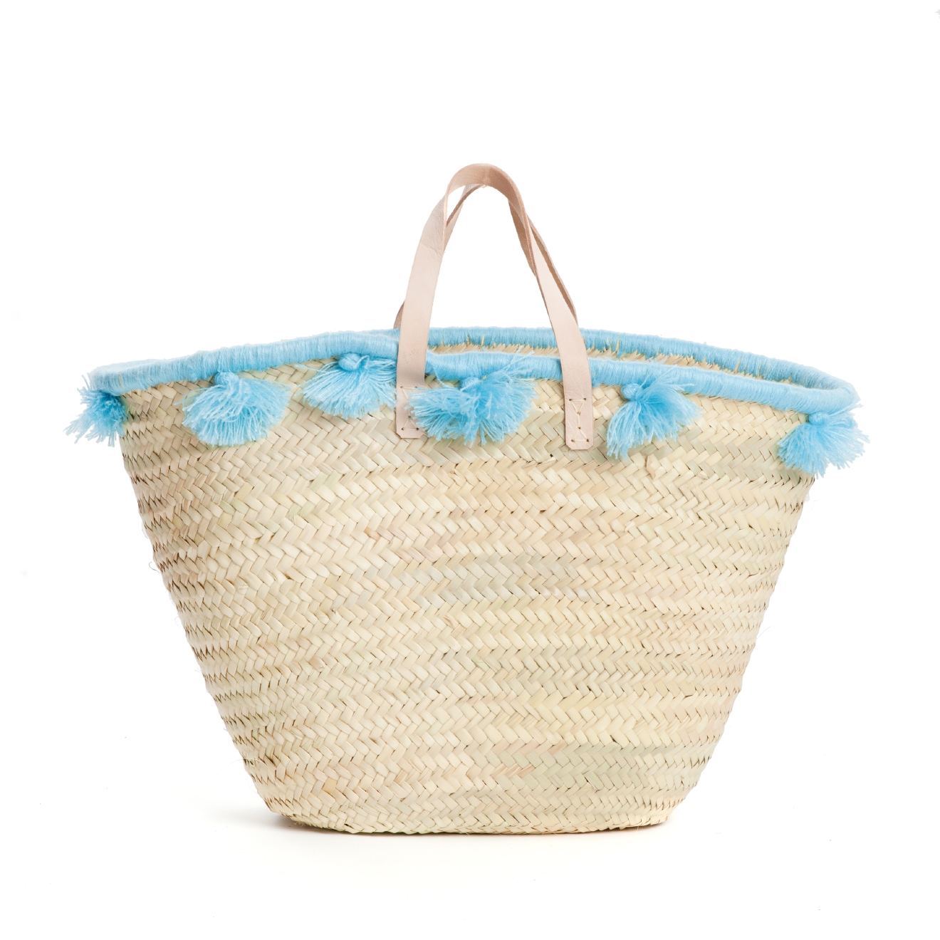 You know you carry your life in your purse so why not make it a fun tassley one! Blue Pastel Pom Pom French Basket, $75, tnuck.com  (Image courtesy Tuckernuck)
