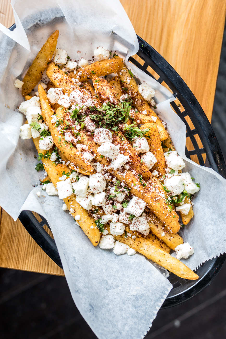 Greek Fries served with feta cheese and dressing / Image: Catherine Viox{ }// Published: 1.26.20