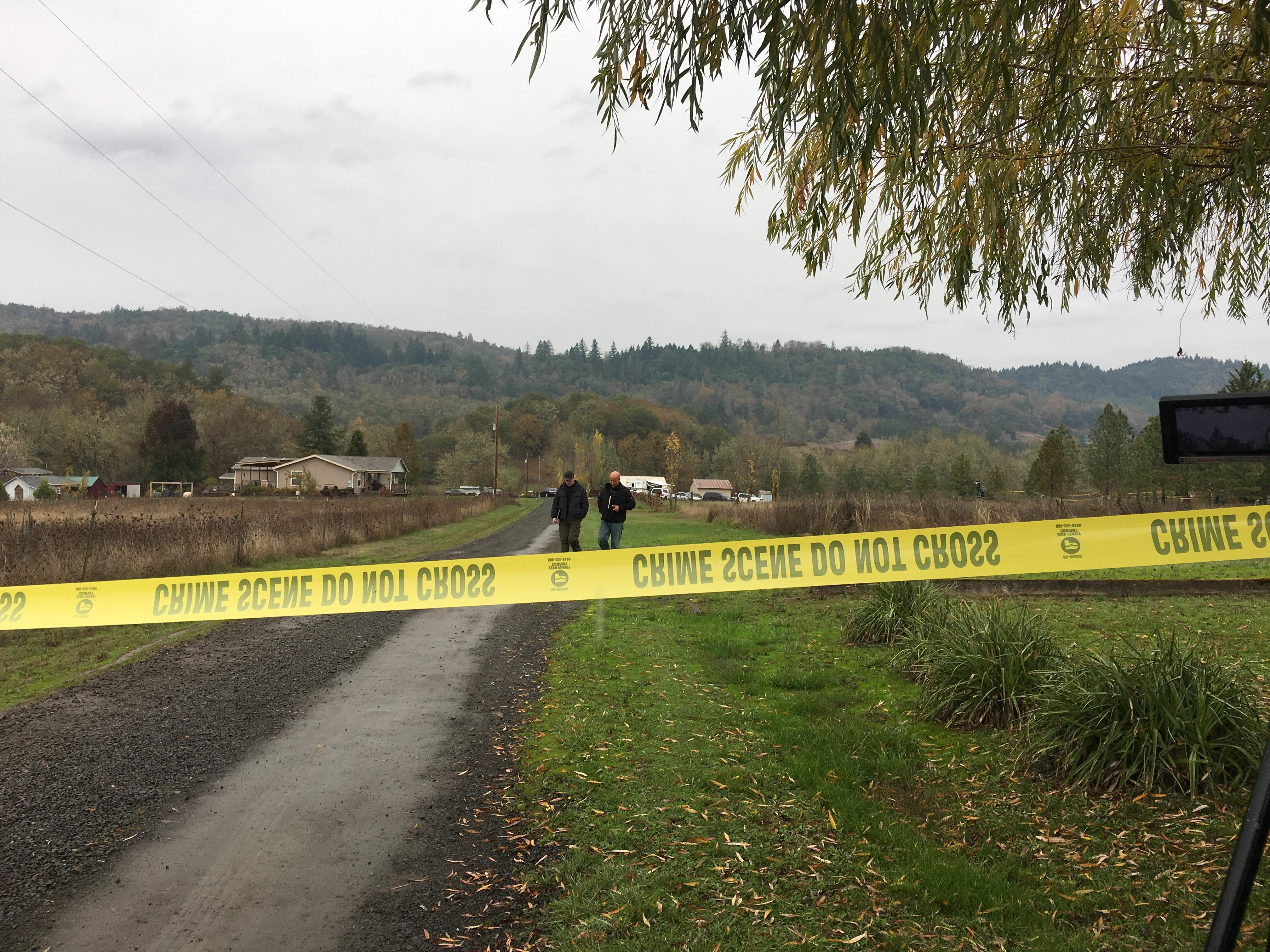 Police tape ropes off the scene as police investigate after three people were found dead in Lookingglass, southwest of Roseburg, Ore., Nov. 8, 2017. (SBG)