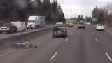 Watch: Motorcyclist rides on back of car after I-5 crash in Tumwater
