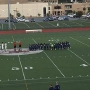 World of Inquiry soccer team kneels during anthem