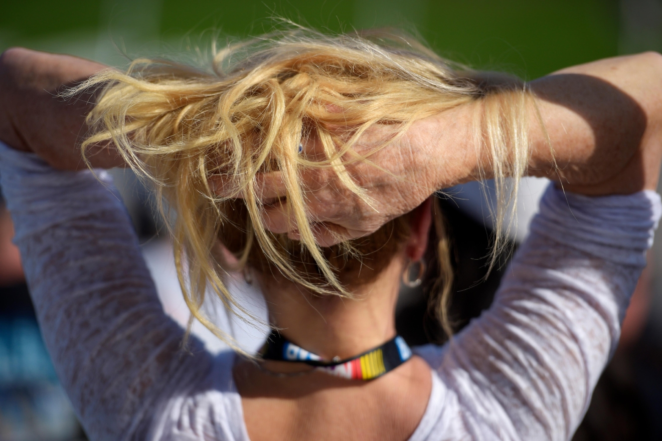 A woman rests her head in her hands during the NASCAR Xfinity Series Boyd Gaming 300 Saturday, March 11, 2017, at the Las Vegas Motor Speedway. (Sam Morris/Las Vegas News Bureau)