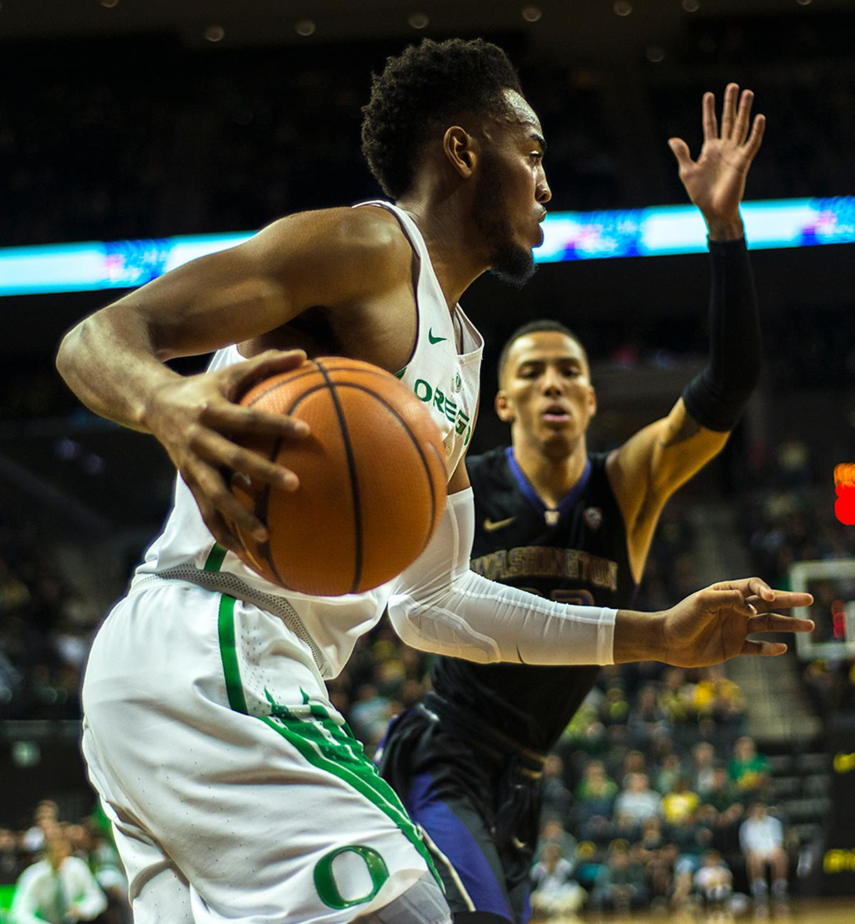 Oregon Ducks forward Troy Brown, Jr., searches for a path around the Washington Huskies defense. The Oregon Ducks defeated the Washington Huskies 65-40 on Thursday night at Matthew Knight Arena. Troy Brown, Junior led Oregon with 21 points to match his career high, and Kenny Wooten set a career best of seven shots blocked. The Ducks now stand 6-5 in the Pac-12 conference play. Photo by Abigail Winn, Oregon News Lab
