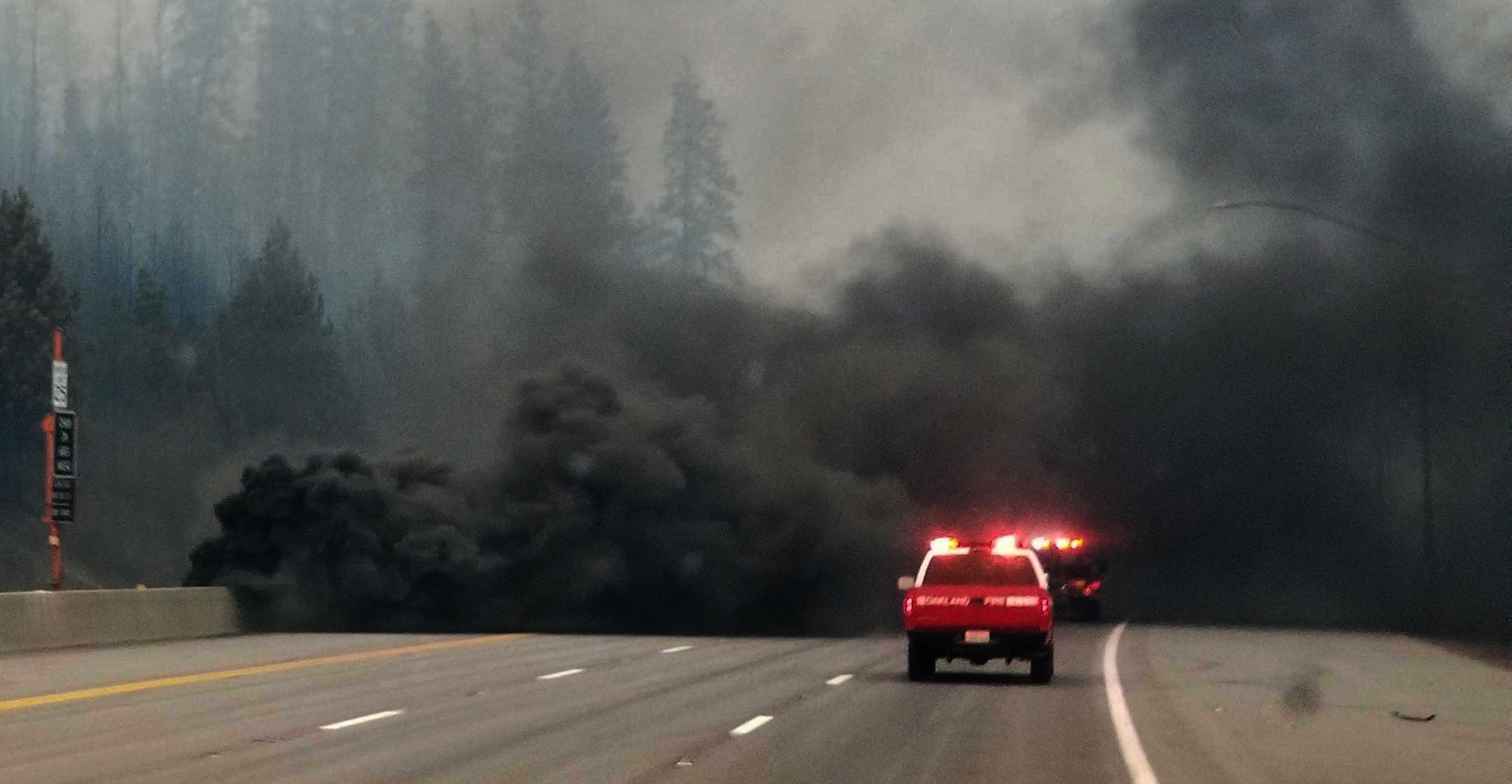 Black smoke engulfs Interstate 5 during the Delta fire.