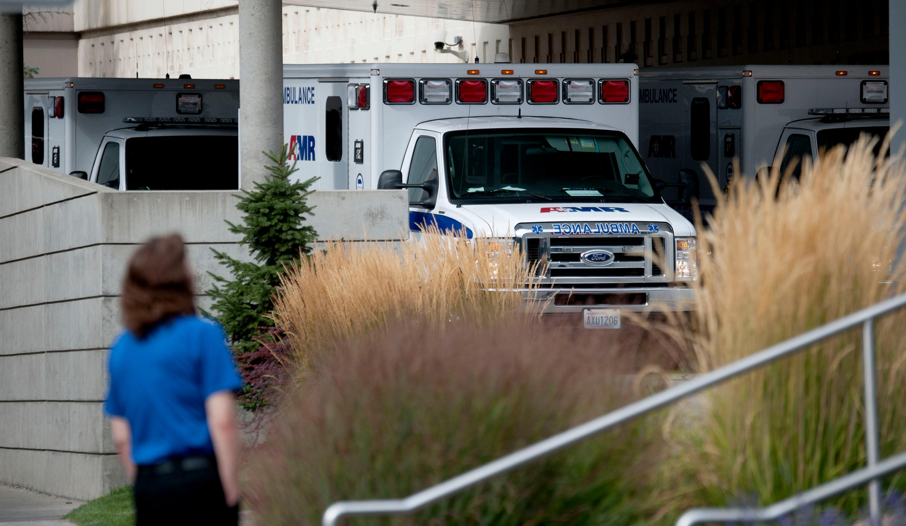 Ambulances line up in the emergency area of Sacred Heart Hospital following reports of a shooting at Freeman High School on Wednesday, Sept. 13, 2017 in Rockford, Wash.  A shooter opened fire at a the high school, south of Spokane, killing one student, injuring three others.  The injured victims were taken to a hospital and expected to survive. Authorities say the suspect was in custody.  (Kathy Plonka/The Spokesman-Review via AP)