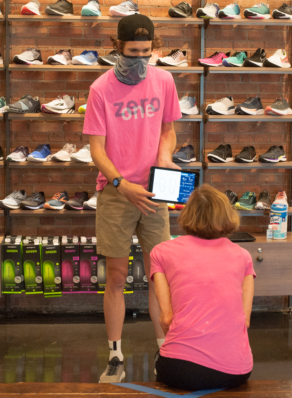 Sales associate Nick Reader assisting a customer with a shoe size / Image: Kellie Coleman // Published: 6.23.20