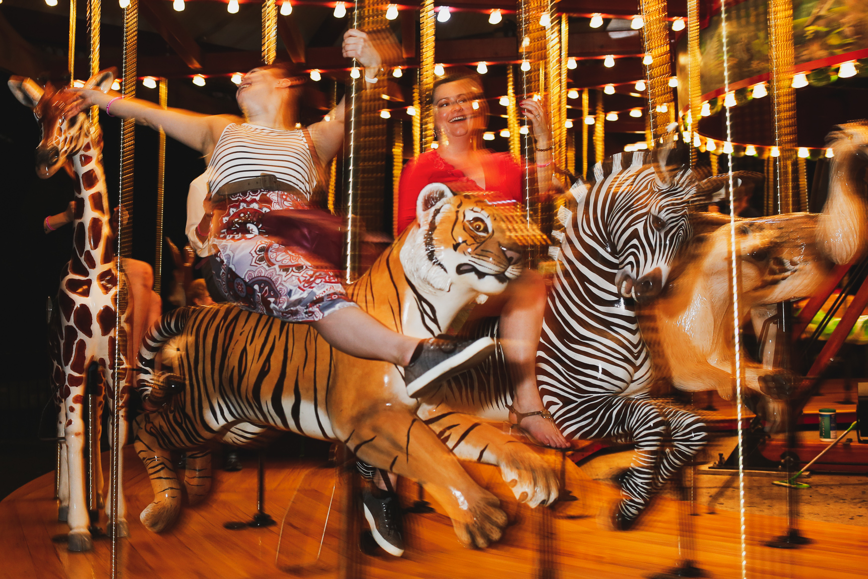 Attendees of the National Zoo's annual Brew at the Zoo take a spin on the merry-go-round in September.{&nbsp;}(Amanda Andrade-Rhoades/DC Refined)<p></p><p></p>