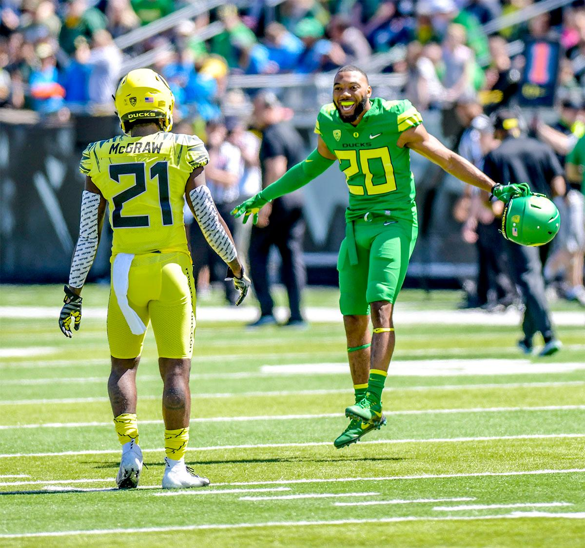Tony Brooks-James (#20) breaks into a dance before the start of the game. The Thunder defeated the Lightning 59-24 in the Spring Game on Saturday at Autzen Stadium. Photo by August Frank