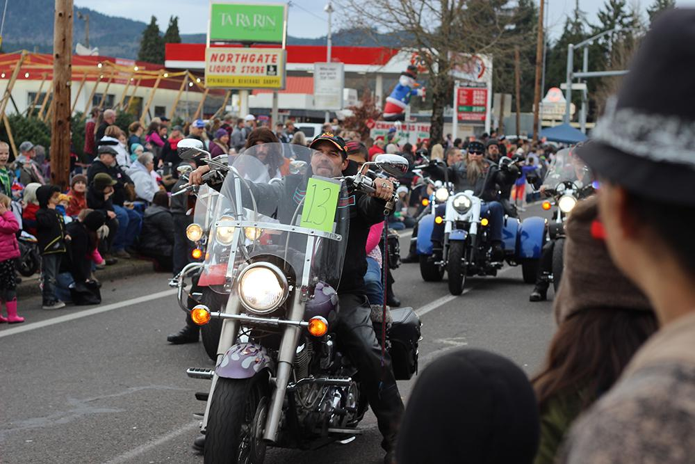 Motorcyclists pass by in the 63rd Annual Springfield Christmas Parade in Springfield, Ore., Saturday, Dec. 5. Photo by Claire Aubin.