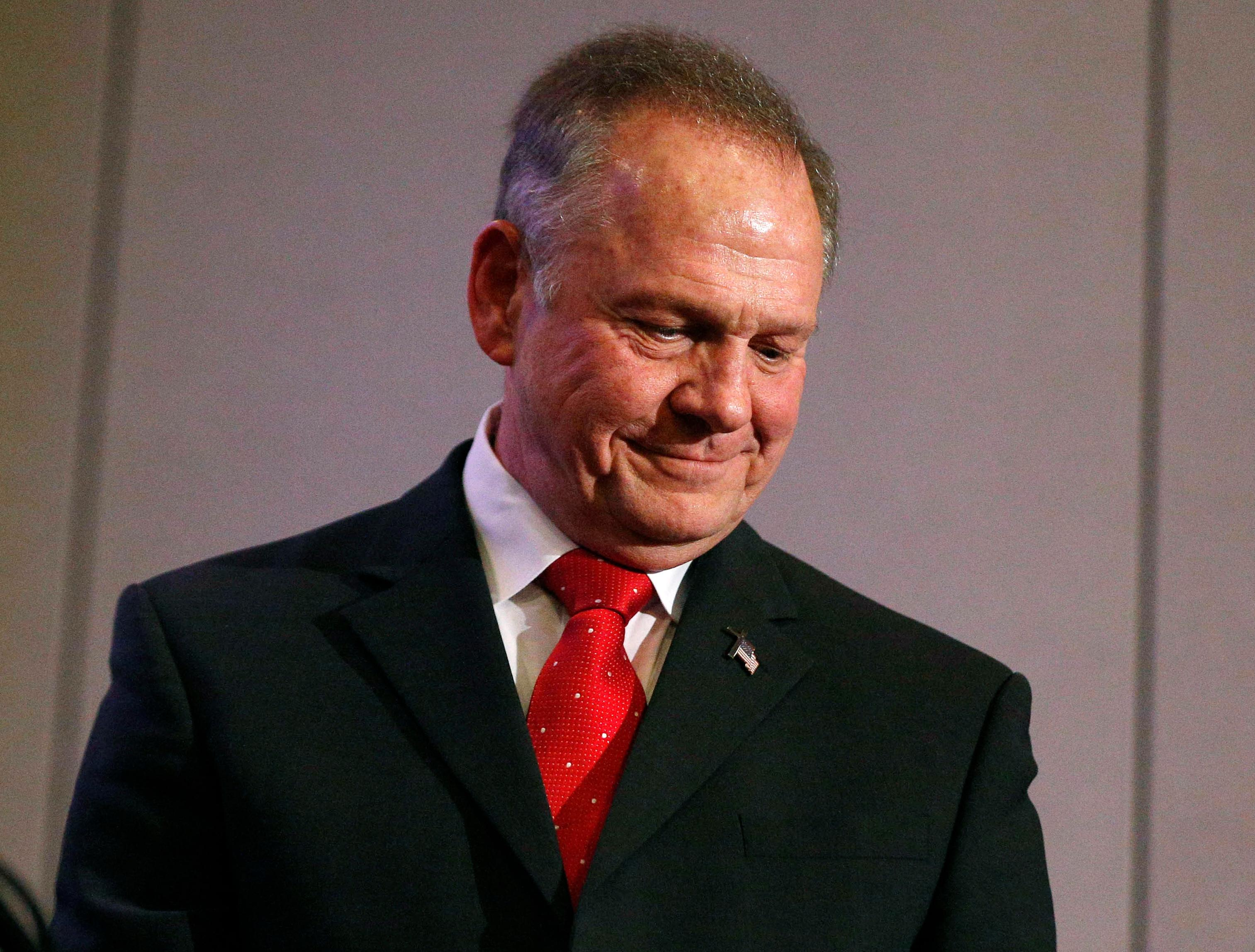 Former Alabama Chief Justice and U.S. Senate candidate Roy Moore pauses as he attends at a news conference, Thursday, Nov. 16, 2017, in Birmingham, Ala. (AP Photo/Brynn Anderson)