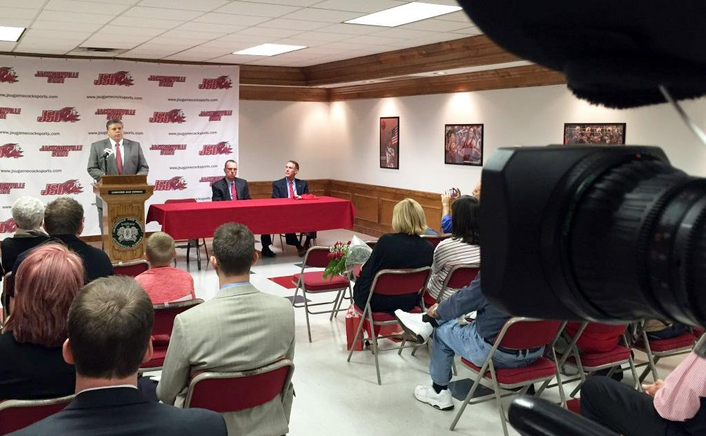 Jacksonville State Athletic Director Greg Seitz introduces Ray Harper as the Gamecocks men's basketball coach at a news conference, Thursday, April 7, 2016. (abc3340.com | Patrick Deavours)