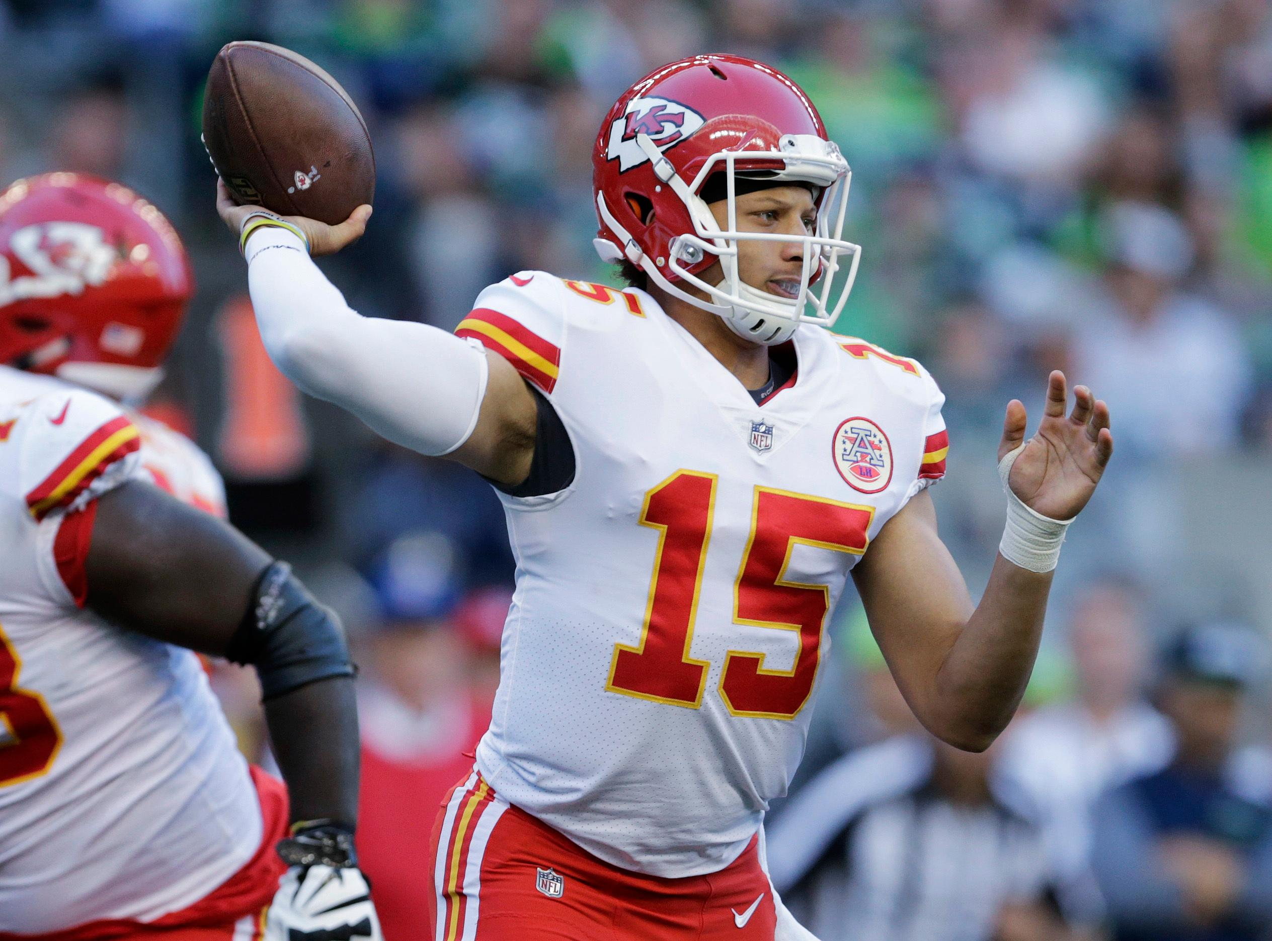 Kansas City Chiefs quarterback Patrick Mahomes (15) passes against the Seattle Seahawks during the second half of an NFL football preseason game, Friday, Aug. 25, 2017, in Seattle. (AP Photo/John Froschauer)