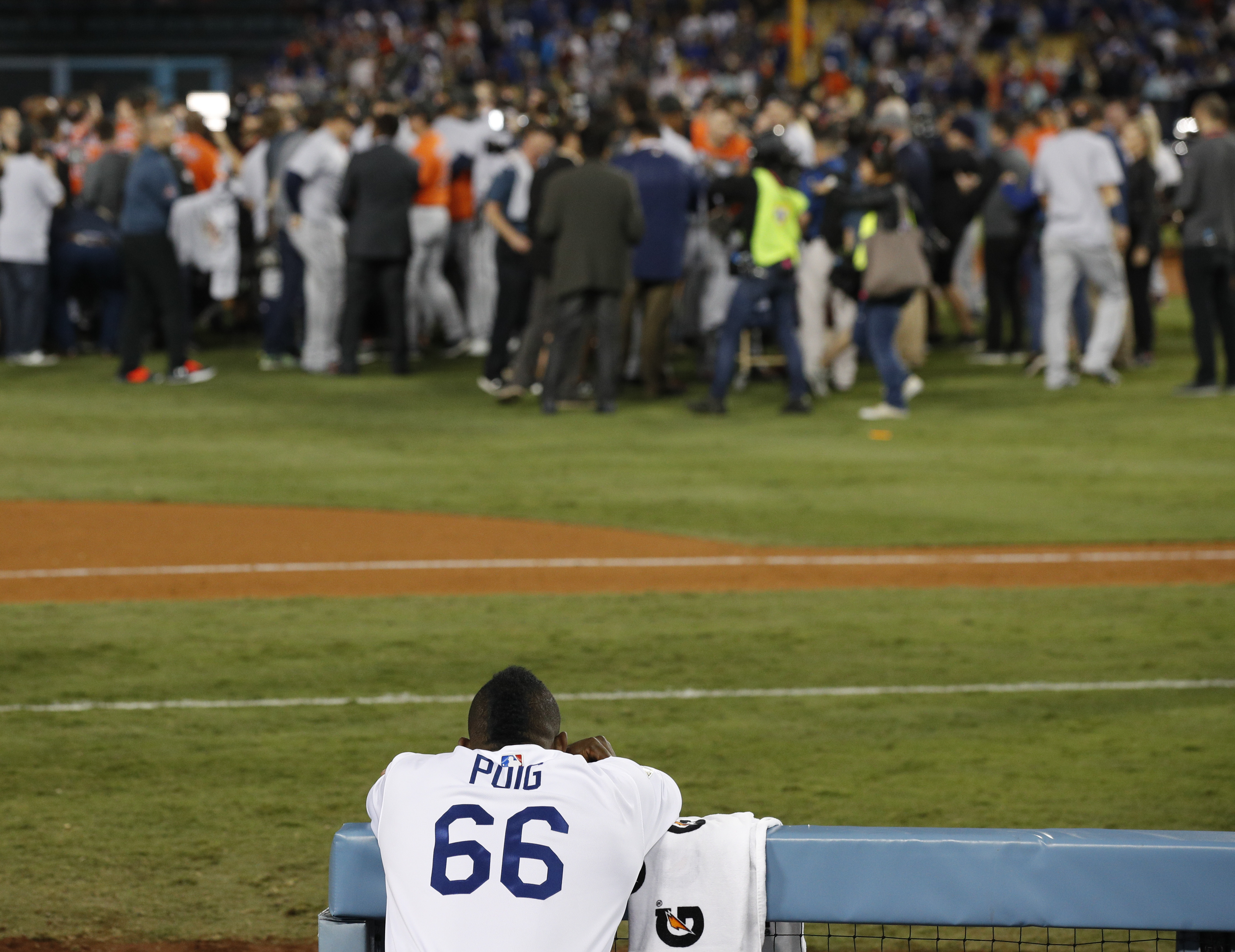 Los Angeles Dodgers right fielder Yasiel Puig watches as the Houston Astros celebrate their win in Game 7 of the World Series Wednesday, Nov. 1, 2017, in Los Angeles. The Astros won 5-1 to win the series 4-3. (AP Photo/Jae C. Hong)