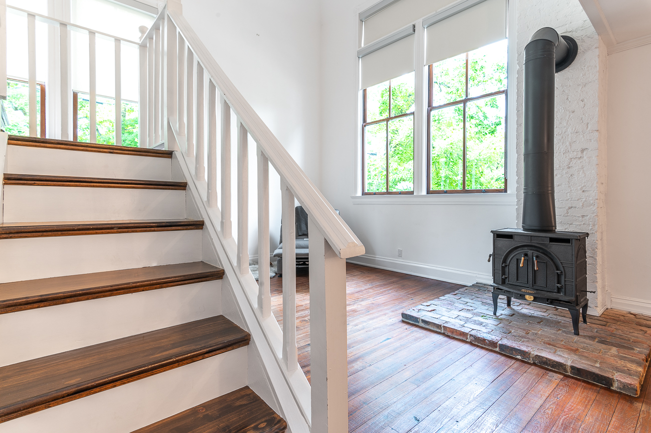 The staircase and old stove in the front room / Image: Phil Armstrong, Cincinnati Refined // Published: 8.19.20