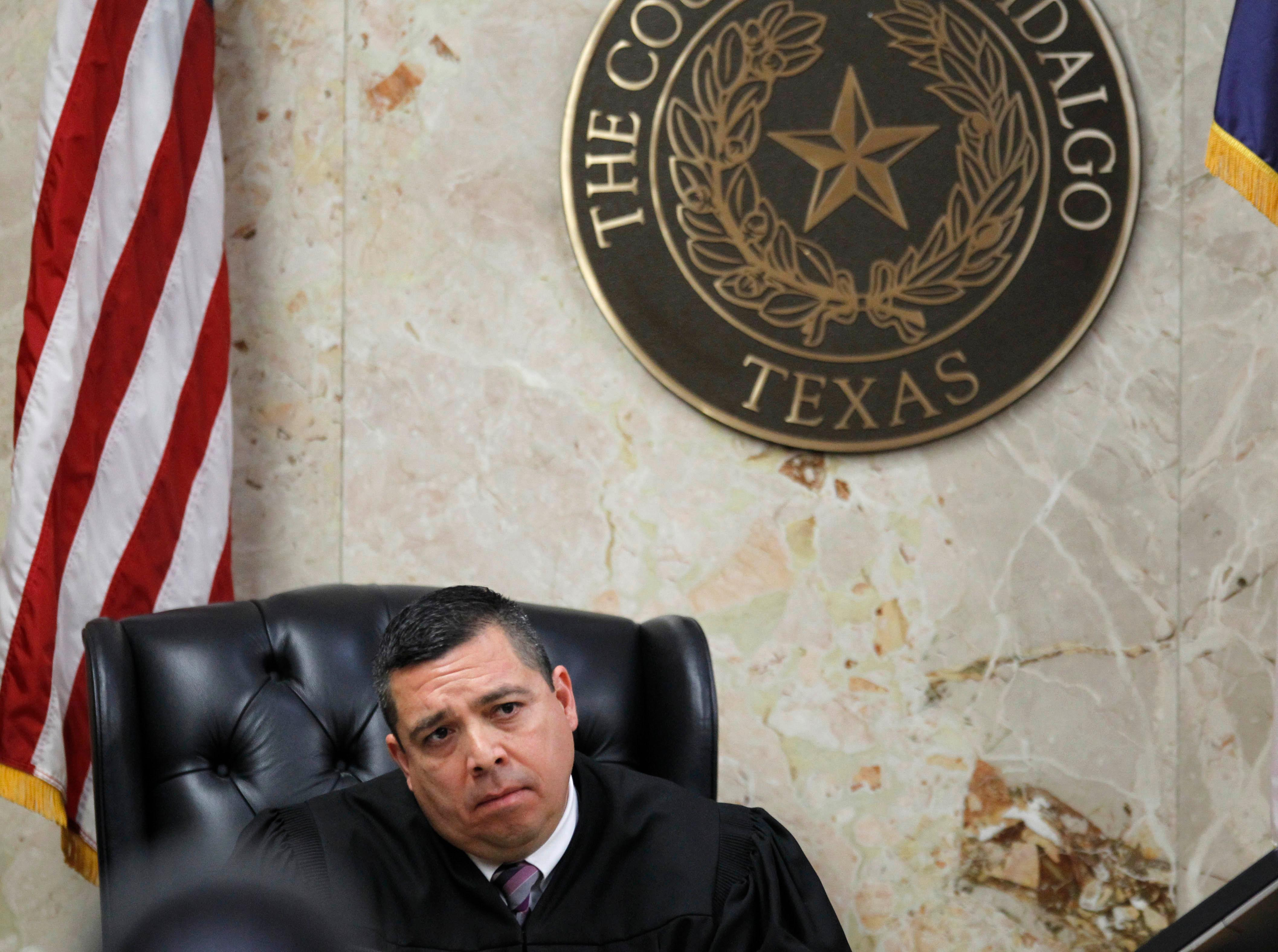 92nd state District Court Judge Luis Singleterry listens to closing arguments during John Bernard Feit's trial for the 1960 murder of Irene Garza Thursday, December 7, 2017, at the Hidalgo County Courthouse in Edinburg. (Nathan Lambrecht/The Monitor/Pool)