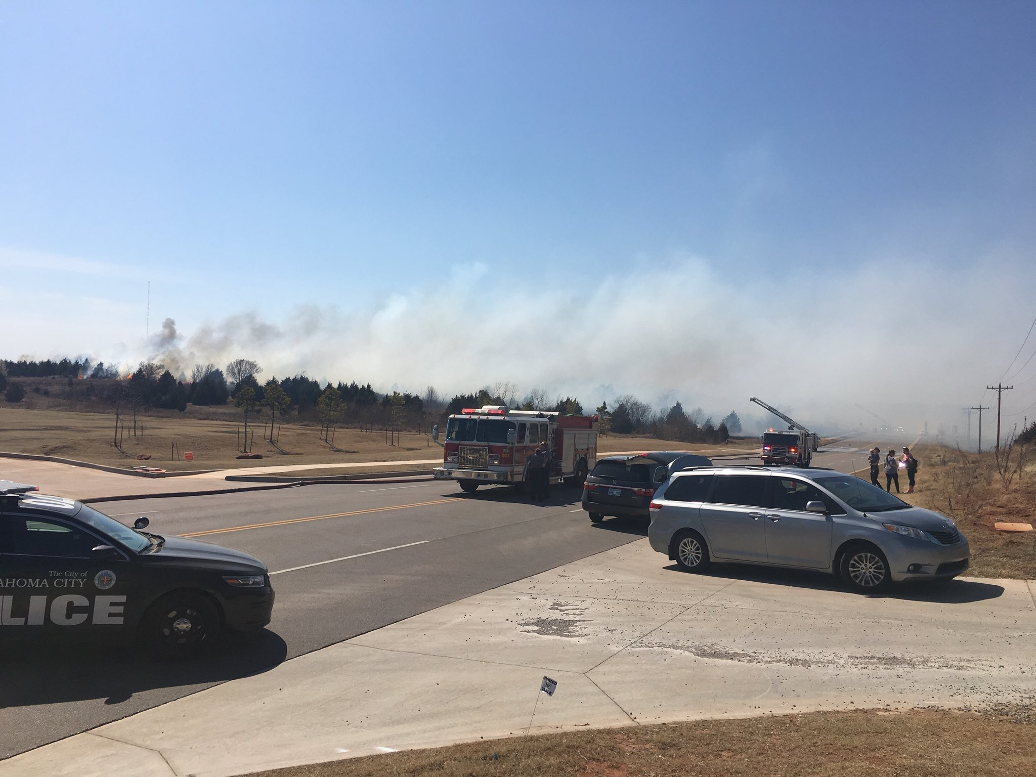 A grass fire burns March 15 near N. Kelley and Hefner in Oklahoma City. (KOKH/Caroline Vandergriff)