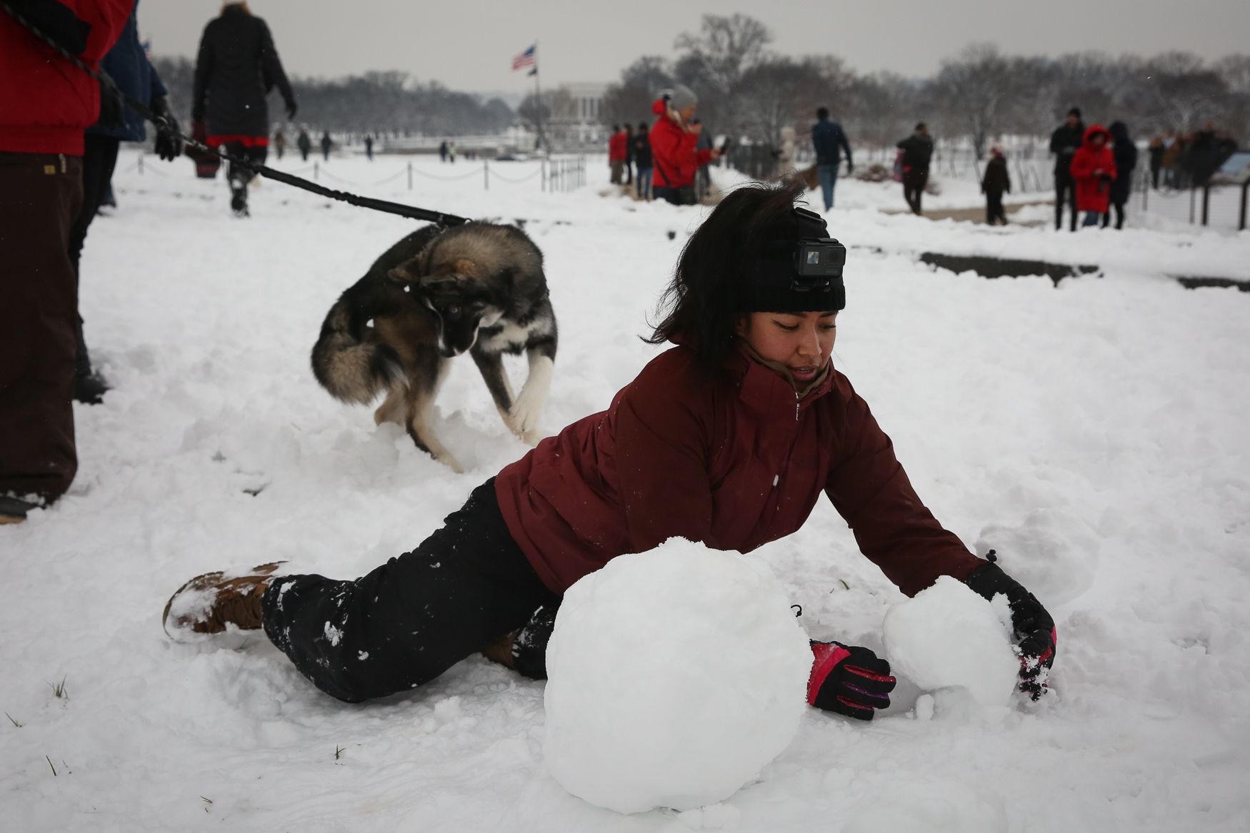 Hundreds of people braved the winter weather to participate in an epic snowball battle on the National Mall on Sunday, January 13. The snowball fight is a D.C. tradition and locals and lucky tourists weren't deterred by the barricades around the monuments due to the federal shutdown. The fun was free and open to everyone, from the young to the young at heart. (Amanda Andrade-Rhoades/DC Refined)