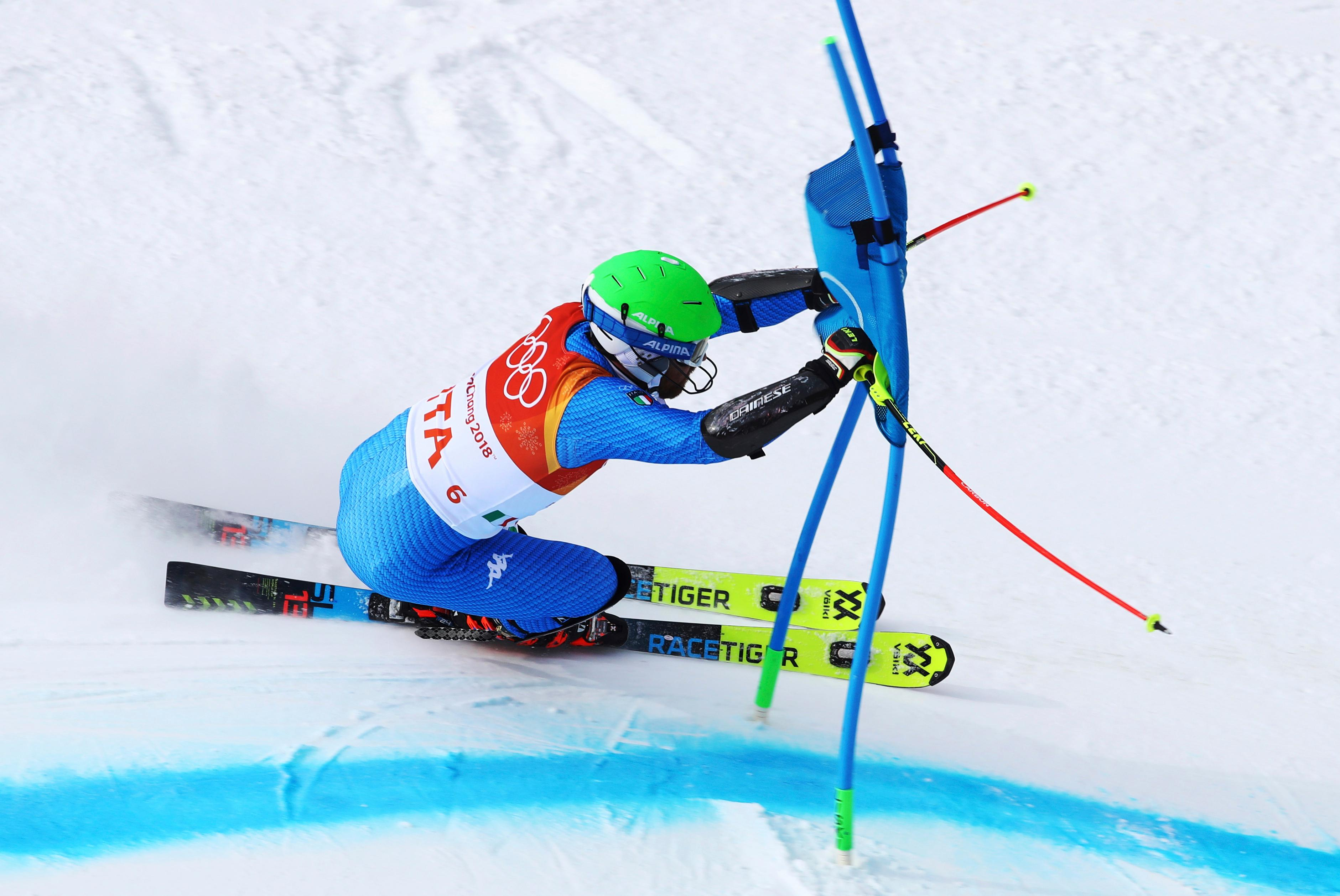 Italy's Riccardo Tonetti skis during the alpine team event at the 2018 Winter Olympics in Pyeongchang, South Korea, Saturday, Feb. 24, 2018. (AP Photo/Alessandro Trovati)