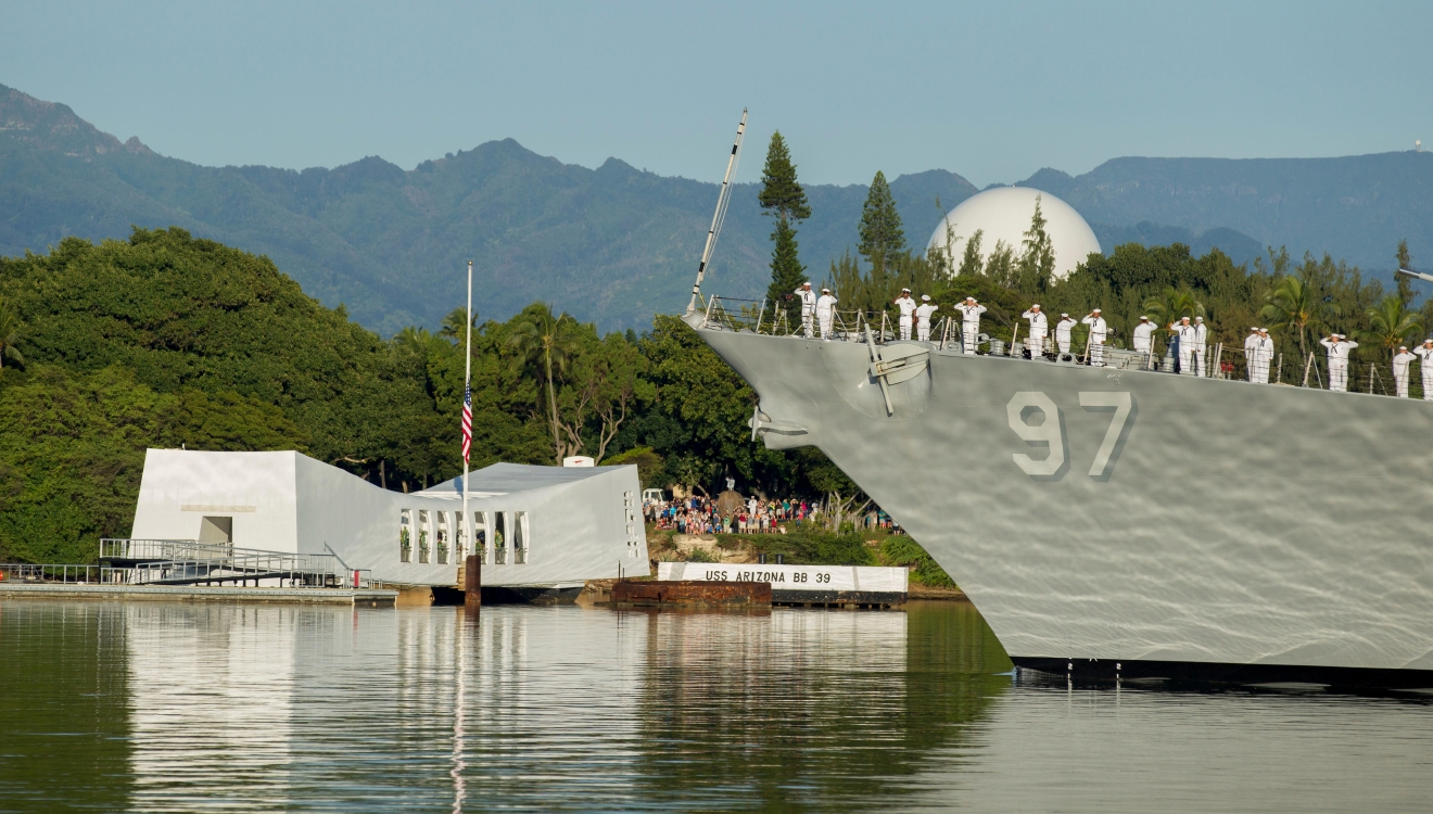 The USS Halsey passes before the USS Arizona Memorial during a moment of silence at Joint Base Pearl Harbor-Hickam, Wednesday, Dec. 7, 2016, in Honolulu. Survivors of the Japanese attack, dignitaries and ordinary citizens attended a ceremony at Kilo Pier to commemorate the 75th anniversary of the Japanese attack on the naval harbor. (AP Photo/Eugene Tanner)