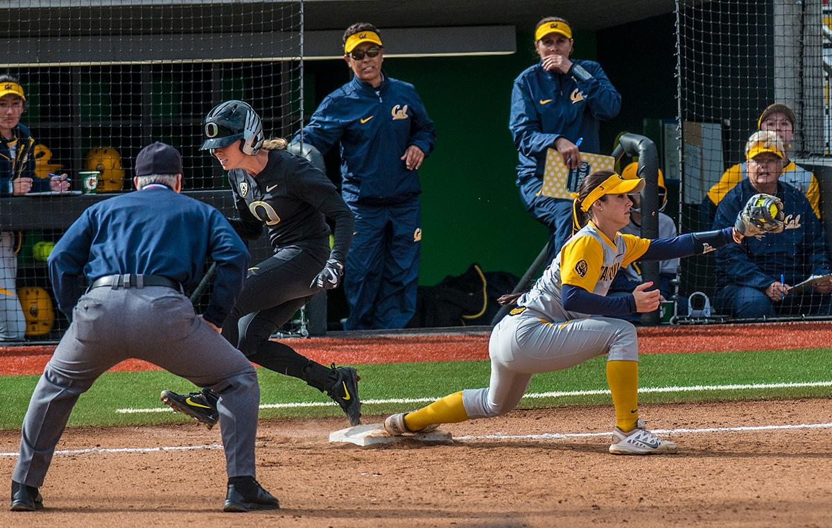 Cal Bears Kylie Reed (#3) attempts to get an out at first base. The Oregon Ducks defeated the Cal Bears 2-1 in game two of a three-game series. Photo by Rhianna Gelhart, Oregon News Lab