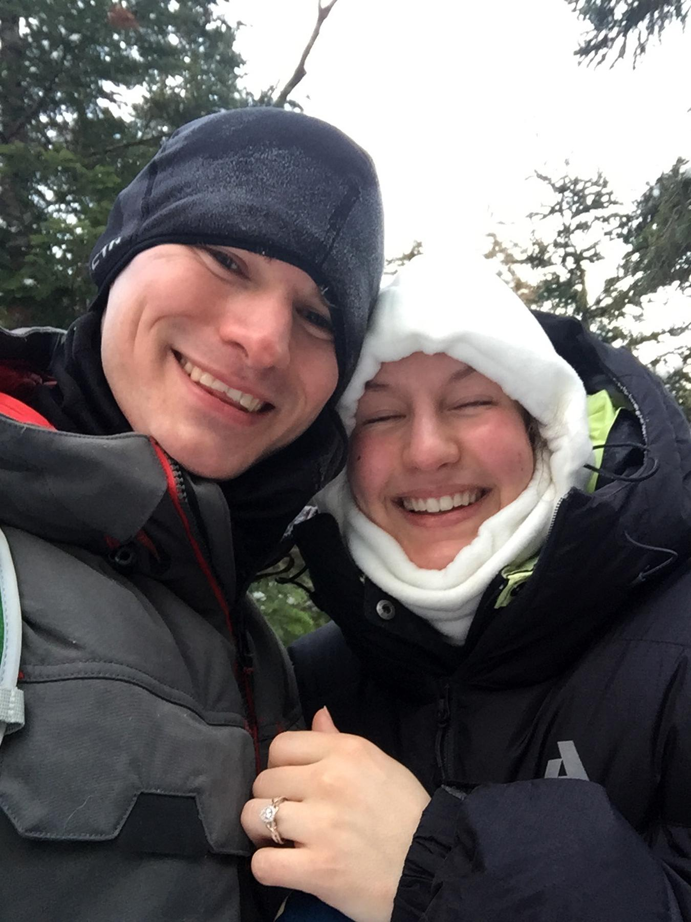 Josh Darnell, of Londonderry, New Hampshire, proposed to Rachel Raske, of Lowell, Massachusetts, on Thursday, Dec. 28, 2017, in Tuckerman's Ravine, New Hampshire, on the same day the temperature dropped to minus-34 (-37 Celsius) on nearby Mount Washington. Raske, of Lowell, Massachusetts, said yes.  (AP Photo/Doug Darnell)