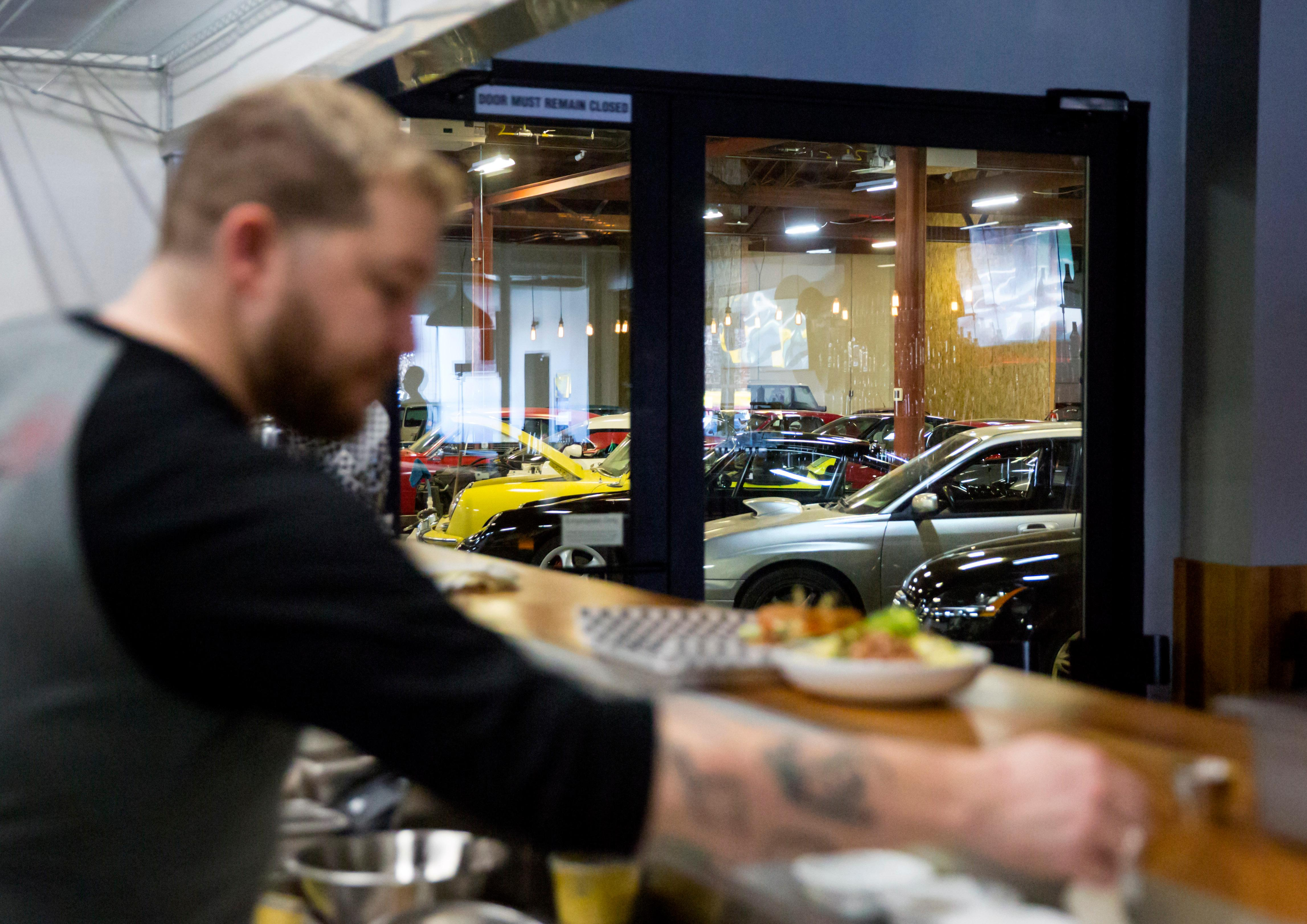 The Shop founder Matt Bell teamed up with Seattle restaurateur Ethan  Stowell to create an all-inclusive dream garage and restaurant called  Derby at The Shop. The Shop includes an indoor area to wash cars, a  hidden poker room for club members, full mechanic lifts, and on-site  mechanic help. (Sy Bean / Seattle Refined)