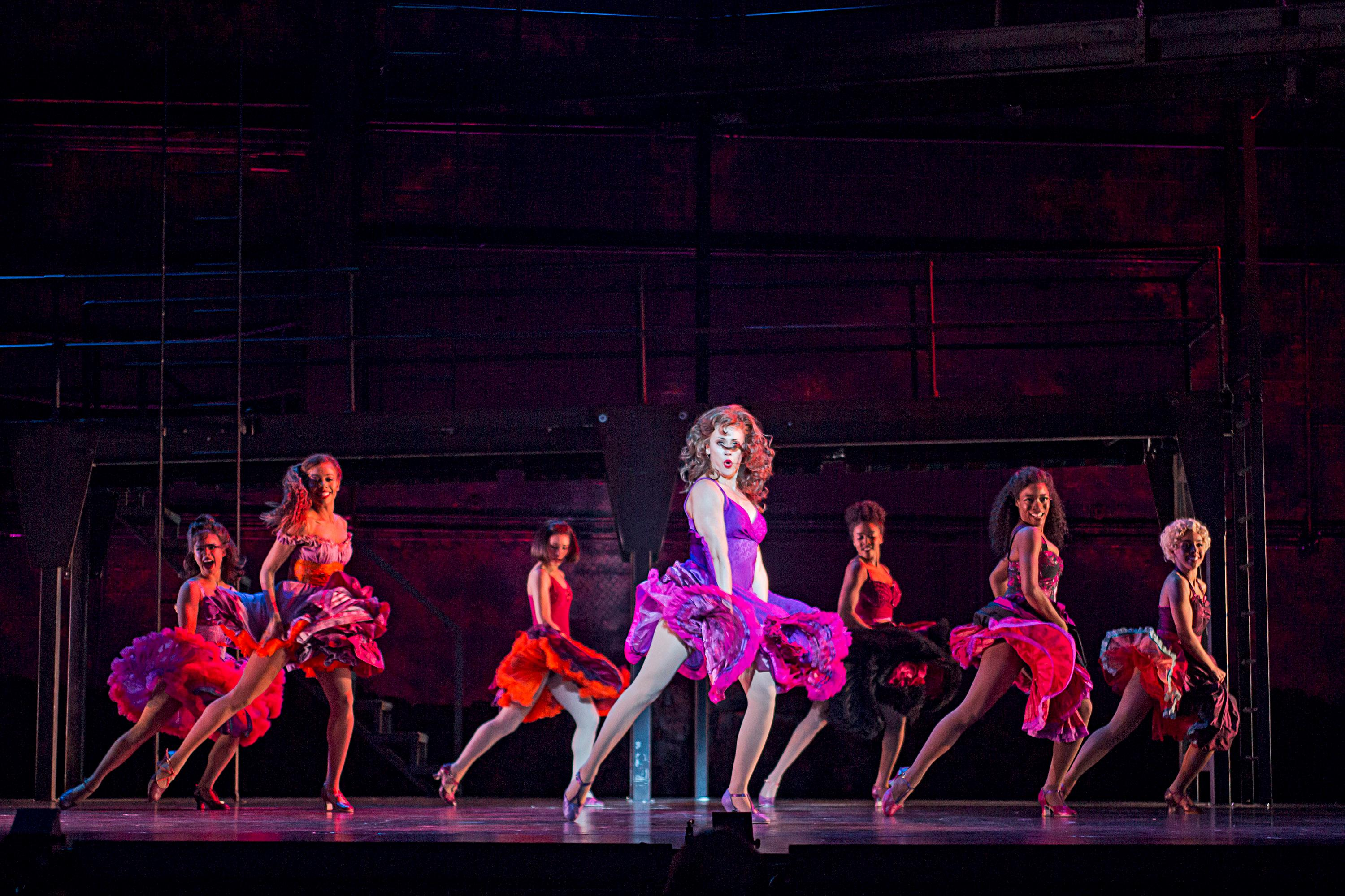 Danielle Gonzalez (Anita) center and the company of West Side Story at The 5th Avenue Theatre (Photo Credit: Tracy Martin)