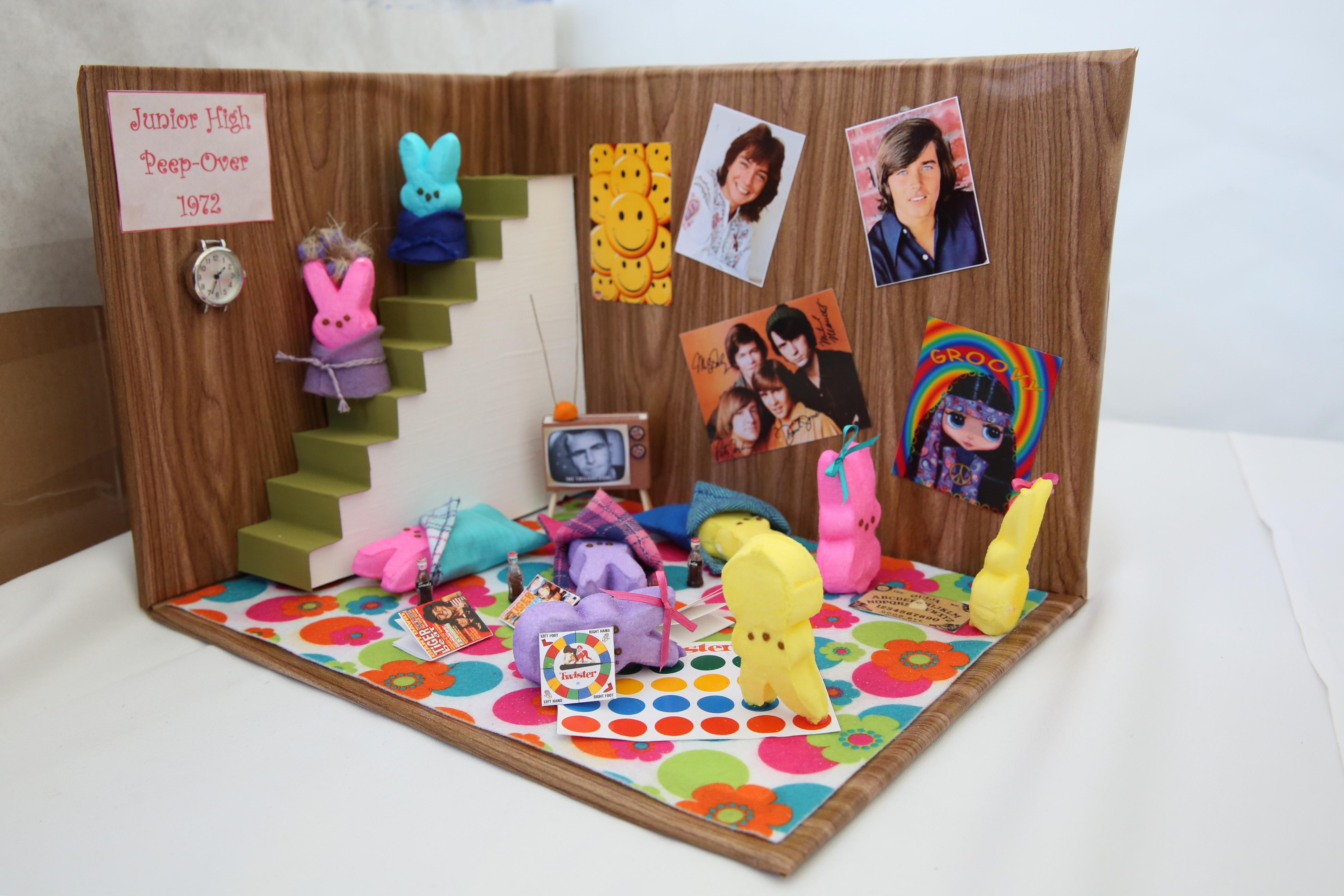 After being axed by the Washington Post, City Paper swooped in to save the annual Peeps Diorama Contest. This year, the Hirshorn's 'Infinity Mirrors' and politics were popular muses, but Bob Ross made an appearance too. (Amanda Andrade-Rhoades/DC Refined)