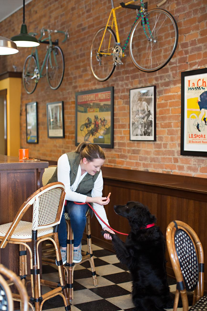 <p>Katie Korthauer, owner of Newberry Bro. Coffee and Bourbon Bar,  with Parker, a flat-coated retriever / Image: Sarah Parisi Dowlin // Published: 11.7.18</p>