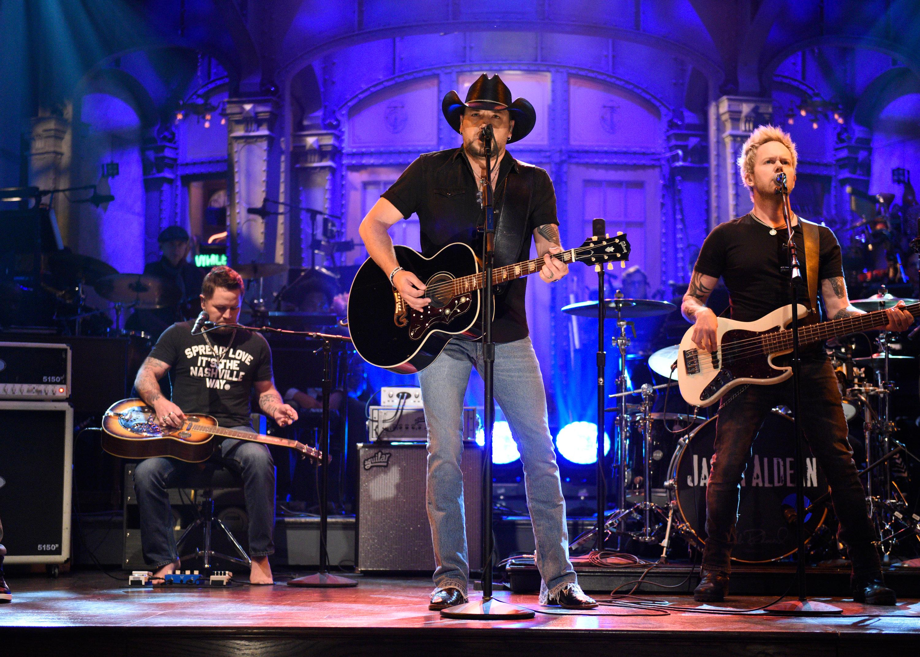 "In this photo provided by NBC, Jason Aldean performs ""I Won't Back Down"" on ""Saturday Night Live,"" Saturday, Oct. 7, 2017, in New York. ""Saturday Night Live"" has paid tribute to the victims of the Las Vegas mass shooting and the late rock superstar Tom Petty by opening its show with country star Aldean singing one of Petty's songs. (Will Heath/NBC via AP)"