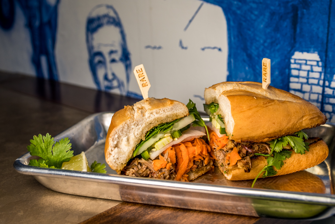 KY Bahn Mi: house-smoked pork, pickled carrots, cucumber, cilantro, jalapeño, and sriracha aioli / Image: Catherine Viox{ }// Published: 8.2.20