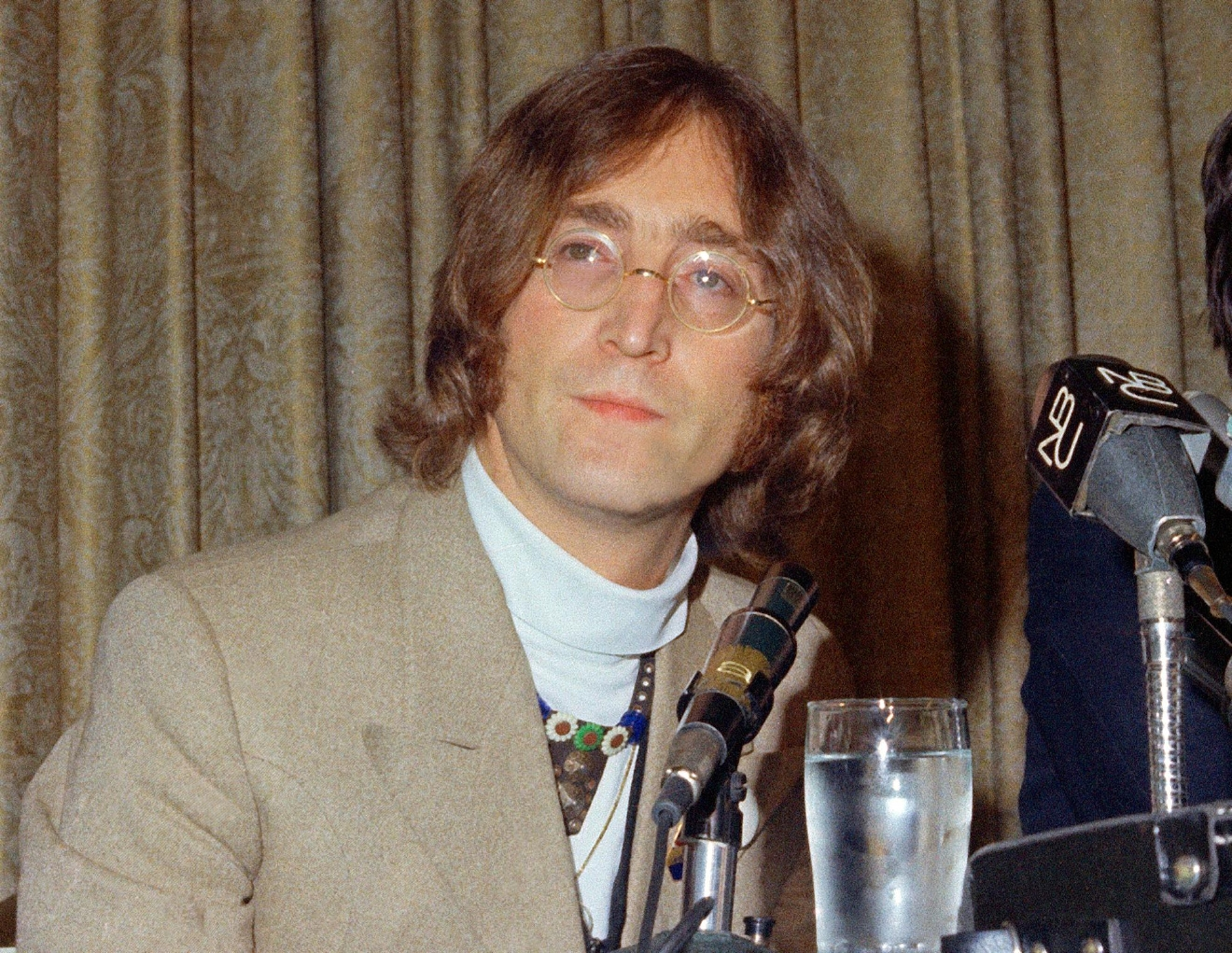 FILE - In this 1971 file photo, singer John Lennon appears during a press conference. (AP Photo, File)