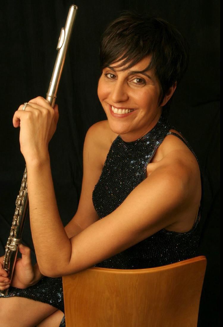 Flutist Marianne Gedigian who has performed with the Boston Symphony and Boston Pops is a featured soloist at the July 4 concert. ABC photo.