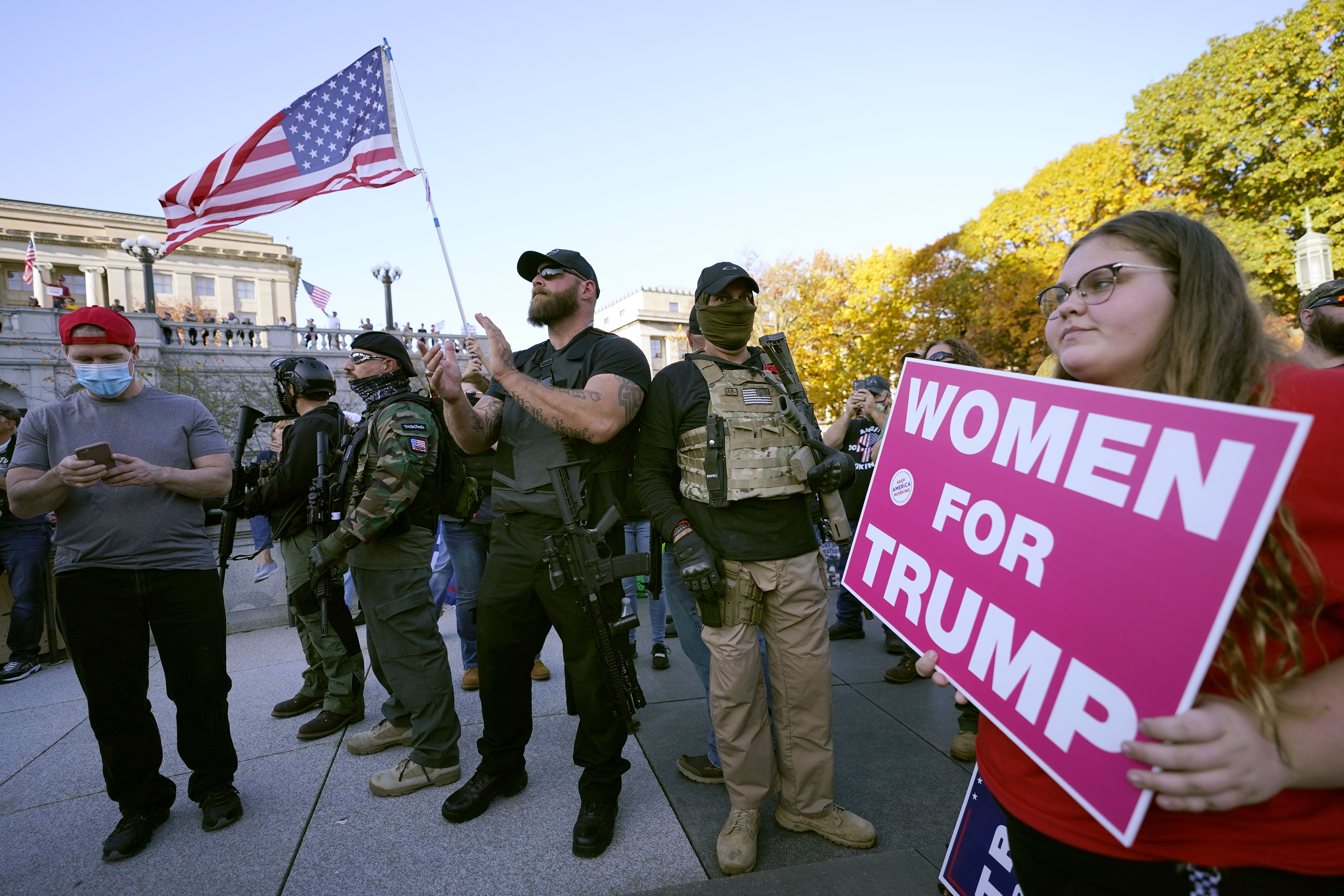 Supporters of President Donald Trump carry firearms while demonstrating outside the Pennsylvania State Capitol, Saturday, Nov. 7, 2020, in Harrisburg, Pa., after Democrat Joe Biden defeated Trump to become 46th president of the United States. (AP Photo/Julio Cortez)