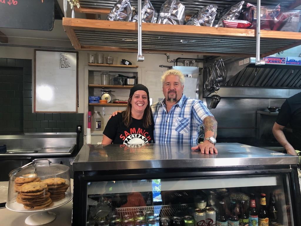 <p>Photo courtesy of Sammich</p><p>Sammich chef and owner Melissa McMillan poses behind the Sammich counter Thursday with celebrity chef Guy Fieri of the 'Diners, Drive-Ins and Dives' TV show.</p>