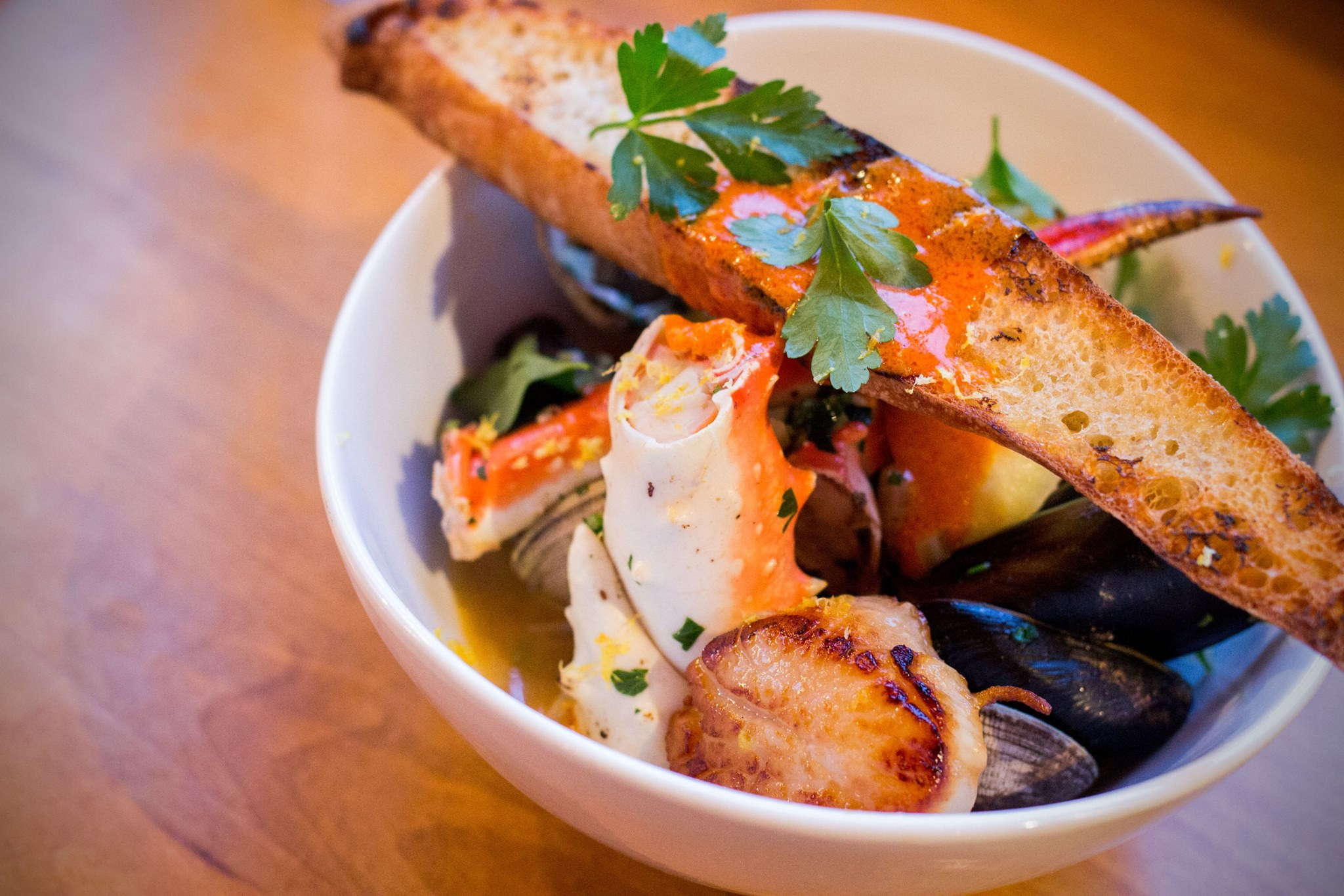 The freshest seafood available in Seattle can be found in the Seafood Stew from Matt's in the Market.  The deeply flavored seafood stew is comprised of local shellfish, fin fish, tomatoes, olives, and caper berries which showcases all the flavors the Puget Sound has to offer. (Image: Matt's in the Market)