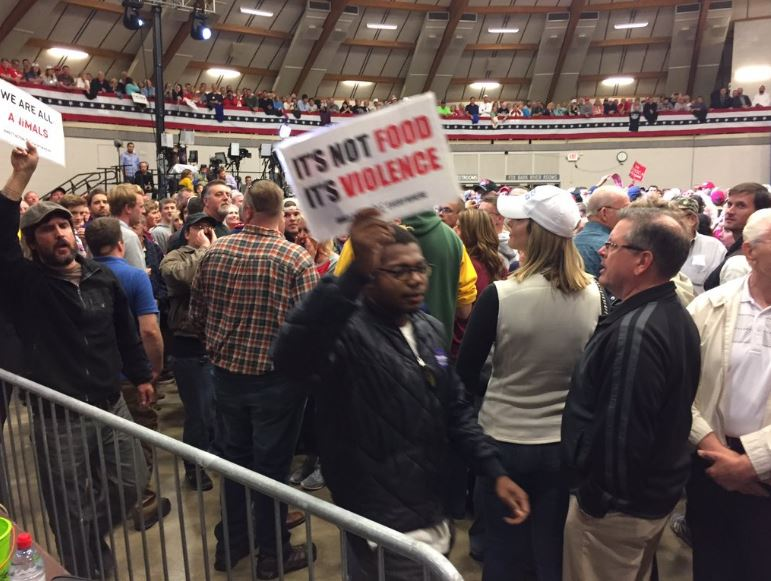 Protesters at a Donald Trump rally in Waukesha, Wisc. escorted out, Wednesday, Sept. 28, 2016. (WLUK/Andrew LaCombe)