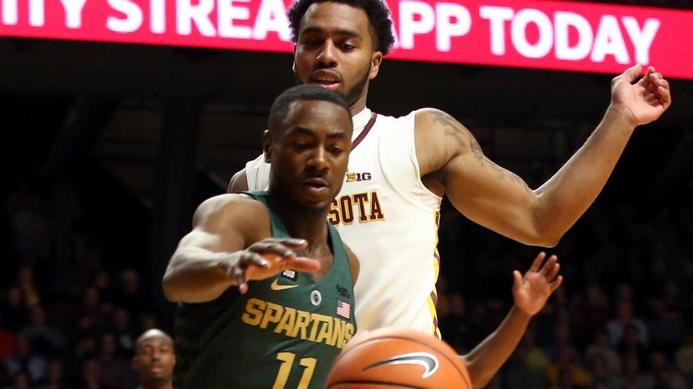 b1f85d7e715c Michigan State s Lourawls Nairn Jr. chases the ball in front of Minnesota s  Jamir Harris during the first half of an NCAA college basketball game  Tuesday
