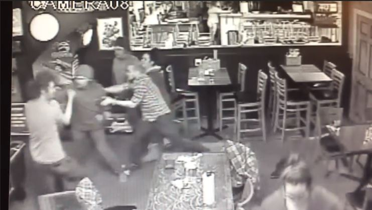 Deputies are looking for one of two men who attacked a man in a Colorado bar. The attackers punched the victim in the face while he held his daughter in his arms. (Jefferson County Sheriff's Office)
