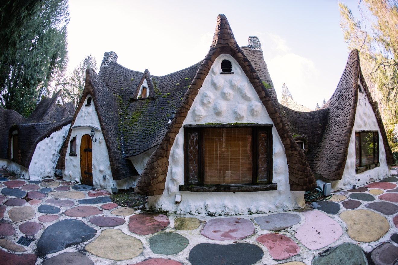We went to Snow White's cottage in Kitsap County and toured the 4 bedroom, 4.5 bath home for sale. This storybook home features meticulous detail including the hand build doors, painted rock pavers, hand carved wood beams, stained glass windows and more. Everything about this house makes you feel like you're in Snow White's fantasy world and it could all be yours for $925,000. Located at 3395 SE Hidden Valley Way, Olalla, WA 98359 you can view the listing and learn more here: http://www.johnlscott.com/Home/959347/NWM/3395-SE-Hidden-Valley-Wy-Olalla-WA-98359. (Image: Joshua Lewis / Seattle Refined)